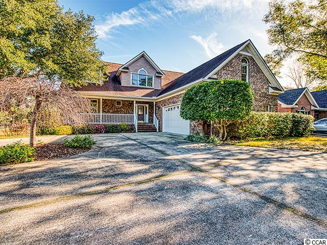 """For those seeking an amenity-rich community ... This all brick home is nestled on a short cul-de-sac and overlooking an attractive community pond with the Heritage Golf Course beyond. A perfect setting just around the corner from the owners' clubhouse with pool, tennis (pickleball on the way!), exercise and card rooms, and a playground and a few minutes from the marina and boat landing on the Intracoastal Waterway. With only one owner, this home has been lovingly maintained. The floorplan is appealing and flexible with a large living room and Carolina room, both with vaulted ceilings, and divided by a shared double-sided fireplace. The kitchen is spacious, well-equipped and updated - plenty of counter and cabinet space, pantry, and open to a large, comfortable dining area. The laundry room and powder room are conveniently located off of the kitchen. Also on the ground floor, you will find two bright guest bedrooms with a shared hall bath.  Up the """"back stairs"""" you'll find a loft-type bonus room that would be perfect for a game room or considerable home office. Beyond the bonus room is a partially finished space that could easily become an additional bedroom/guest quarters with a half bath. Up the """"front"""" stairs, you will find a quaint, private master suite with dressing area, massive walk-in closet, and bath area with shower and garden tub. 114 Berwick Drive offers endless possibilities in a community packed with lifestyle features. Heritage Plantation is a private, gated community with 24-hour security. It was thoughtfully developed around an impressive golf course along the Waccamaw River with careful attention to preserve mother nature's lowcountry virtues. Let's see what life would look like for you in this special place!"""