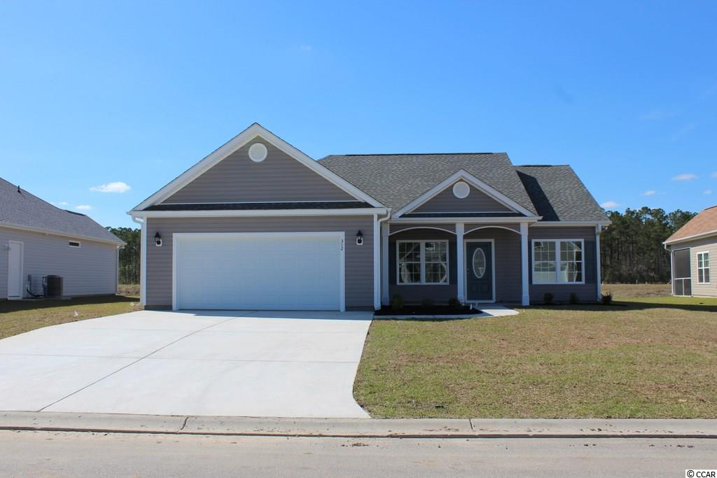 Popular 3 bedroom Pecan floor plan, relaxing front porch, rear screen porch and patio. Open floor plan, dining area, living room has vaulted ceiling, ceiling fan, large kitchen has lots of solid wood cabinets with crown molding, breakfast counter, stainless steel appliances - microwave, smooth top stove, dishwasher, and pantry closet. Split bedrooms - Master suite has vaulted ceiling with ceiling fan, large closet, double sink in raised height vanity, 5' walk-in shower, linen closet and window to let the light in. Guest bedrooms and bath on opposite side of the house. Wood look vinyl flooring in dining room, living room, kitchen and hall. Spacious finished/painted 2-car garage, with automatic door opener, pull down stairs to attic storage above and a side door. Irrigation system, gutters, mailbox, sodded and landscaped yard. Community pool. Award winning local builder. Aynor Schools. Less than 1 mile to Hwy 22, within 30 minutes of Myrtle Beach. Photo's and video are for illustrative purposes only and may be of a similar home built elsewhere. Square footage is approximate and not guaranteed. Buyer is responsible for verification.