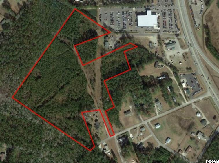 17.7 ACRES OF PRIME COMMERCIAL REAL ESTATE adjacent to North Strand Nissan in Little River, SC. Property is currently zones CFA (Commercial Forest Agriculture). Allowed uses are Agriculture, forestry, low-density residential, commercial, social cultural, recreational and religious uses. Ideal for car wash, mini storage, medical facility, assisted-living, apartment/multi-family housing, or other commercial uses. Property is an assemblage of five (5) parcels that are accessible from Saw Horse Drive & Calvary Road. Owner willing to subdivide. 2018 SCDOT Average Daily Traffic Counts approximately 26,300 on Hwy 9. Public utilities are available on the site. U.S. Army Corps of Engineers determined that no wetlands were located on the Property. Property is located in close proximity to McLeod Seacoast Hospital & Medical Facilities (1.7 Miles) as well as city of North Myrtle Beach (3 Miles).  Easy access to Highway 9, Highway 57, Highway 31 & Highway 17.