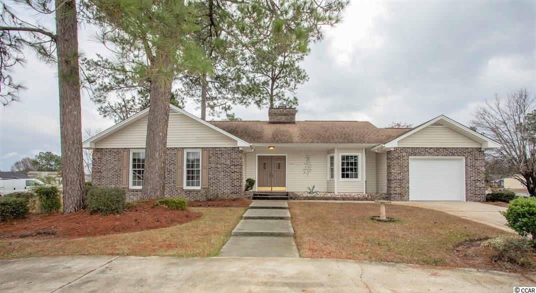 Lovely 3BR-2BA home in Carolina Lakes community of Myrtle Beach.  This home has great curb appeal with a circular driveway on a large corner lot. The spacious living area has a beautiful brick (wood burning) fireplace, vaulted ceiling with skylights and ceiling fan. Located off the living room is the dining area with french doors that leads to the patio and a fenced back yard. The galley kitchen features tile flooring, breakfast nook, plenty of cabinets & a pantry. The hall bathroom has a unique second vanity located outside the door. The roomy master suite has two walk-in closets. Carolina Lakes is located on Route 544 just on the back side of the Legends Golf Course and conveniently positioned to Routes 31 & 501, hospitals, restaurants, shopping, Coastal Carolina University and of course the beach. Even better is NO HOA!  All measurements are approximate.  The buyer is responsible for verification.