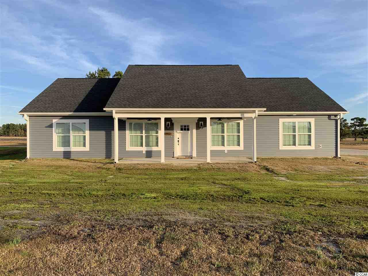 This Home is To Be Built! Come now so you can lock in the opportunity to pick out your own colors, cabinetry, counter tops and other Finishes! Home is to be on a spacious 3.3+/- Acre Lot just minutes from Hwy 22. No HOA, and plenty of space for outside storage! Located just a short 20 minute drive to the beach! The house pictured is a similar style home already built. Several Lots to choose from, and many other different homes with different floor plans. Call today to schedule your free consultation!
