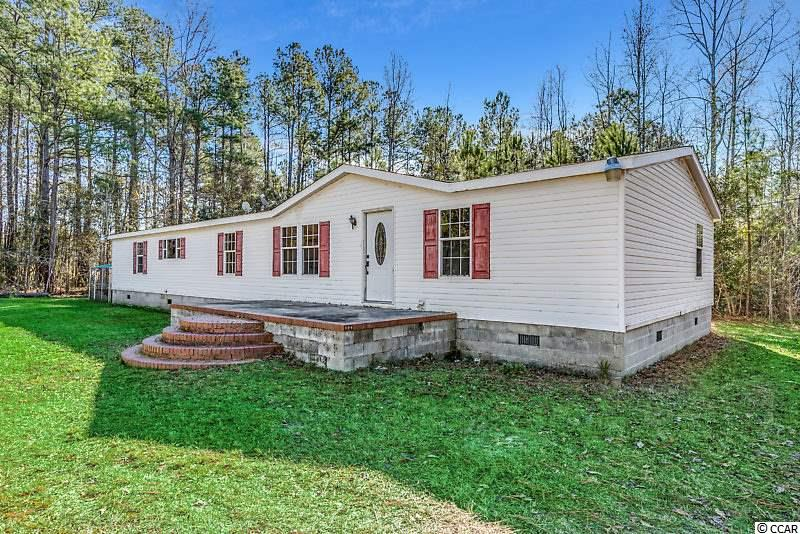 PRICED BELOW APPRAISED VALUE. 4 Bed 3 Bath of quiet living on 2 Acres! What a value, this large 2000+ square foot home off the beaten path has been freshly painted throughout the main living area showcasing the open floor plan accented by tons of natural light. The HVAC was replaced near the end of 2018 and the home is ready for its new owners. Two separate living areas allow everyone space along with 4 large bedrooms including a master with a large en-suite bath. While the backyard is not cleared, there is plenty of clearings and paths to enjoy your recreational activities on the acreage. Square footage is approximate and not guaranteed. Buyer is responsible for verification.