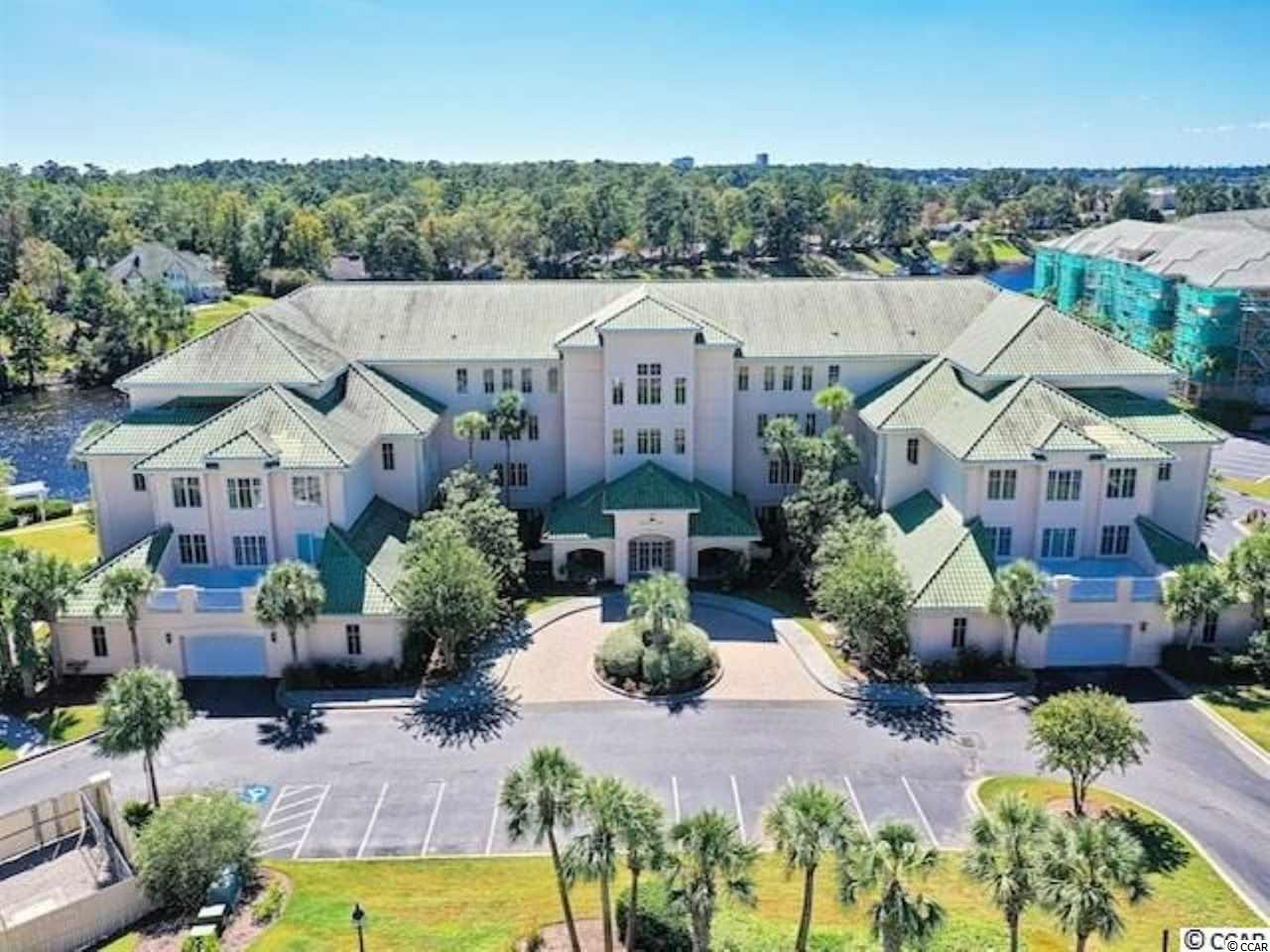 Welcome home to this elegant, 2 bed 2 bath, condo in the desirable Edgewater community right on the Intracoastal Waterway (ICW) at Barefoot Resort! Property includes a transferable golf membership and rare access to a boat rack to tie up a boat. This unit has been kept in pristine condition, with a lovely view of the ICW and manicured landscape of the grounds. Features include a  washer & dryer, stainless steel appliances, tile floors and carpet throughout,  screened-in balcony, and an amazing master suite with tray ceiling, walk-in closet, and an ensuite bath with dual sinks, large garden tub and walk-in shower. Edgewater is truly a dream location for owners who want the ease of less maintenance responsibility and, overlooking the ICW and the fun of amazing amenities including walking trails, fishing areas, recently restored boat docks, the Barefoot Marina and a private oceanfront cabana with gated private parking for owners and guests and a summer shuttle service to and from the beach.  Edgewater residents enjoy the security of a gated community and the luxury of access to social clubhouse, two pool areas equipped with a deck and cabanas, a hot tub & state of the art fitness center, as well as Barefoot Resorts 4 championship golf courses with 2 clubhouses & a driving range and use of the North Tower pool. You have the best of waterway living and easy access to all the shopping, dining and entertainment the Grand Strand has to offer!
