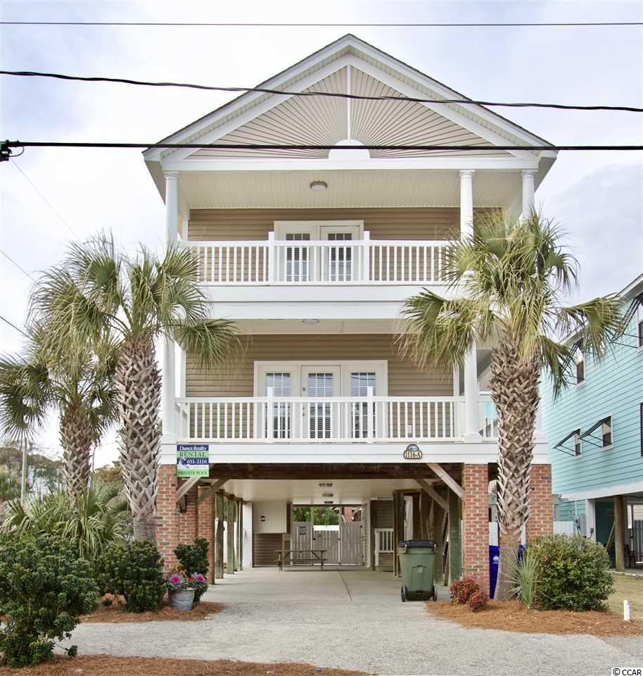 Vacation rental income other owners wish they had!  Consistent and very strong repeat business  - 19 weeks already booked for 2020 by mid January.  Call for specifics.  Elegant yet livable, this beautiful 5BR 5BA second row home is loaded with amenities, including an elevator, a private 12'x24' gated and heated pool and it has ocean views! It is located on a large professionally landscaped corner lot on the south end of Surfside Beach. Completely renovated with crown moldings, upscale flooring and fine furnishings, done for the long term not a cheap flip job.  New Trane HVAC system installed 11/19.  This raised home offers two master suites, two covered front decks with ocean views, a resurfaced private heated pool, an elevator to the main level and a handicapped-accessible living area on the first floor (although this is not an ADA approved property). The elevator had a major overhaul in 4/19 for its new owner.  A fully equipped kitchen with high end stainless steel appliances, full-size HE washer & dryer and a park-style charcoal grill with picnic table are among its other amenities. And since it is a corner lot, there is plenty of parking and beach access is directly across the street. This is a must-see!