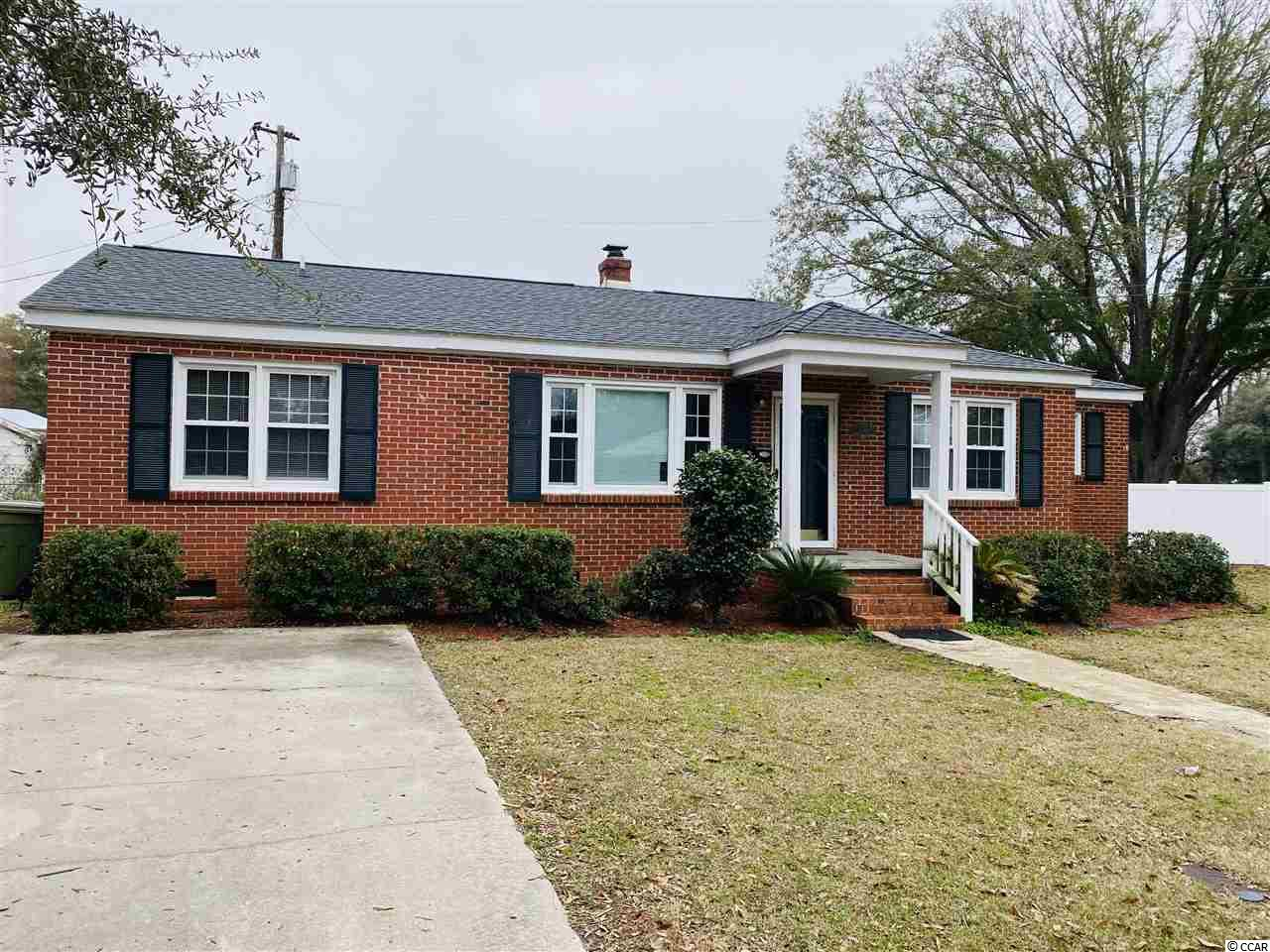 "Bring your things, 1309 Saville Street is ready for you! This is a fantastic 3 bedroom 2 bath home, with so many updates including newer roof and HVAC, and is ""Move in Ready""! Nestled within Richmond Plantation neighborhood, you're close to the newly remodeled Tidelands Hospital, grocery stores and just a mile from the downtown shops and restaurants of the Historic District. This home has it all from hardwood flooring throughout, a dining room and separate living area. With all of this and more, your mind should be put at ease while renting and loving, this one level, brick home.  Each applicant is required to pass a SLED Credit and Background check."