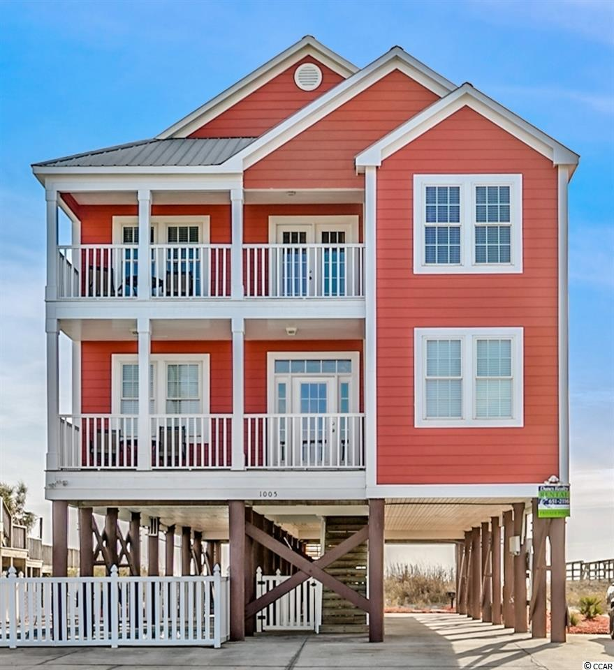 1005 South Waccamaw Drive, known as Daddy-O, is located oceanfront in Garden City Beach 1.1 miles south of the Garden City Pier. The fully furnished home is seven bedrooms, six full bathrooms, measures 3272 heated square feet, comes with a private heated pool, hot tub, two 32x10 oceanfront and two 21x7 covered porches. On the main level, there is a large oceanfront living room, dining room that leads to the kitchen with stainless steel appliances and tile backsplash. There is also two bedrooms, two bathrooms. Upstairs you'll find a loft living area, five more bedrooms, and four bathrooms. The exterior is wrapped in freshly painted concrete fiber siding, has a metal roof, parking for at least six cars. With access from the house, the main level oceanfront covered leads to the backyard and a private access to the beach. The property is situated on a recently re-nourished beach with multiple dunes and healthy sea oats. You're just steps north of the Marlin Quay Marina, south of the small downtown restaurant district, and minutes to all Myrtle Beach has to offer. The home is currently on a vacation rental program and producing income that can offset the owner's carrying costs. The rental history is available upon request. Why continue to rent when you can own your very own beach retreat.