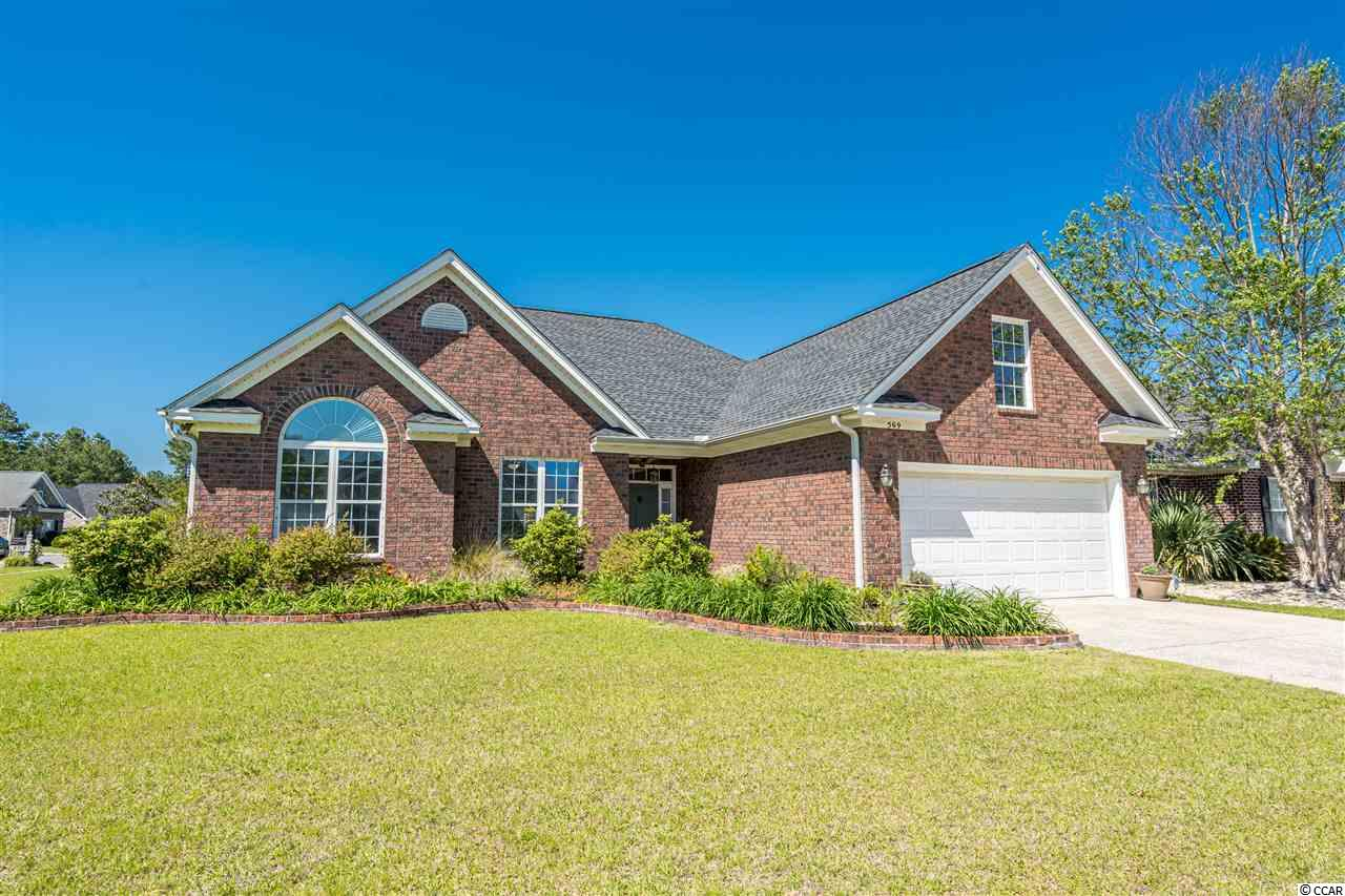 This all brick, corner lot home, is located in a well established and popular neighborhood in Carolina Forest. Covington Lake is located near all shopping, schools and of course the Beach! This beautiful 3 bedroom home has a bonus room over the garage which could easily and comfortably be used as a 4th bedroom, quiet den, office or home gym, whatever you wish! The master suite is located on the first floor and has a beautiful tray ceiling, over sized walk in closet, garden tub as well as stand up shower in the bath and is plenty big enough for your King Sized furniture. Two more bedrooms with large closets and plenty of space are located just down the hall, along with the 2nd bathroom which includes a shower with constructed seat, large vanity and tiled walls. The large open concept living area has tons of natural light, tray ceiling, tiled floors and looks out onto the cover back porch and well manicured fenced in backyard. The Kitchen has newer appliances, granite counter tops with lots of space and plenty of cabinets for storage. There is also bar seating which is perfect for entertaining and which adds to the abundant dining area attached. There is also a walk in pantry conveniently located just off the kitchen near the laundry / mud room. The two car garage is a handyman's dream with work benches and peg board all installed to keep things well organized. This home is located on a corner lot with a water view and has the most amazing plantings in the neighborhood. If you like to garden to have a colorful collection of flowers and bushes this is YOUR HOME!