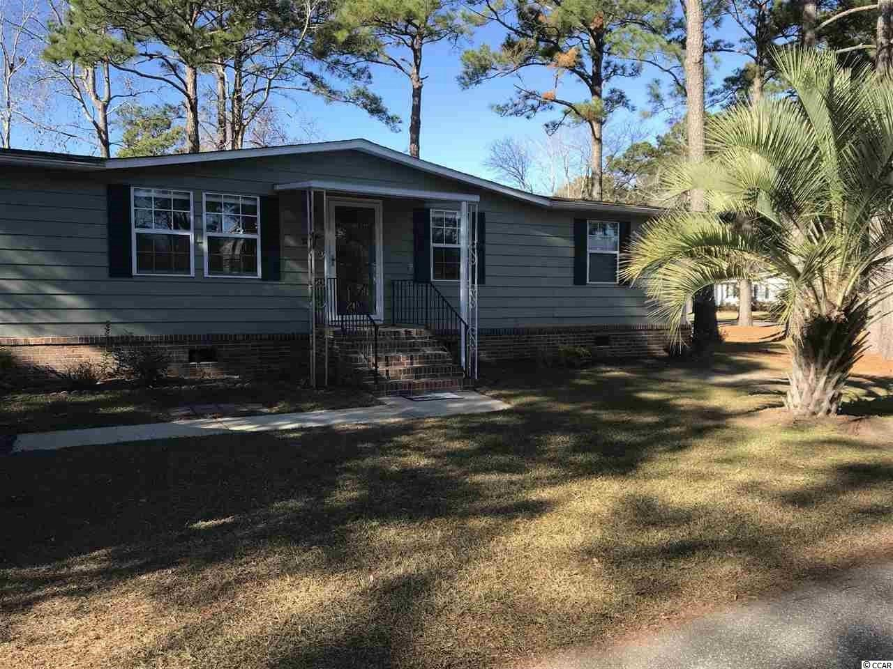Come and see this lovely, recently renovated home in the Ocean Pines 55+ community (formerly known as Jensens).  This move in ready 3 bedroom home with large sun porch is located on a corner lot and located just about a mile to the beach. New vinyl wood flooring throughout, recently renovated eat in kitchen with new cabinets and formal dining room makes this home a must have. Master Bath has a walk in shower and Master closet space has California Closet System. This unit also has upgraded sheetrock walls.  This awesome location ensures you easy access to all of the amenities Murrells Inlet has to offer including fine dining, the marsh walk and shopping.  Community has two pools for you to use as well as a community club house that offers lots of activities for the residents to participate in. Shed in the back yard is wired with electric.   Monthly fee includes the pool, club house and trash pick up.  Pets allowed.