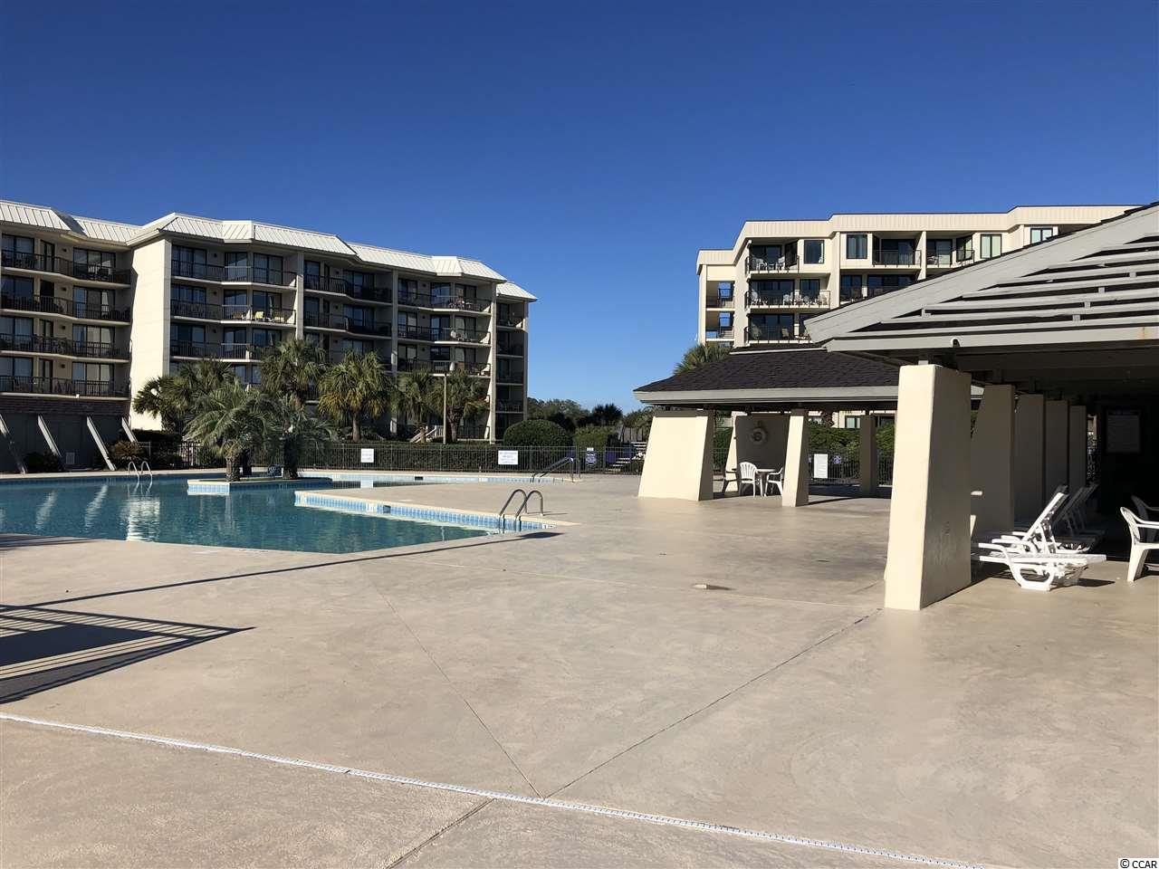 Litchfield has some of the greatest beaches in the world! White sugar sand as far as the eye can see, and no high rises to flood the beach with people, even in the high season! This is a great buy for a 4 bedroom ocean front condo at Litchfield By The Sea. The end unit allows for a great private balcony with wonderful views of the ocean and dunes. Pool, tennis courts, private beach access are only some of the advantages to this community. Close to great restaurants, 30 minutes to the Myrtle Beach Airport, 10 minutes to the Murrells Inlet Marsh Walk and 1.5 hours to Charleston.  Call to schedule a showing today!