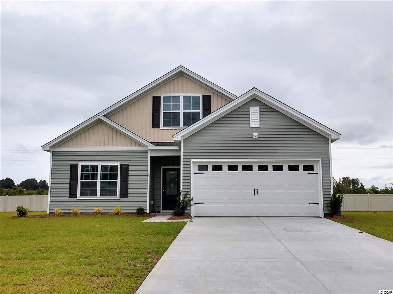 """Natural Gas Community! Great location - easy access to Conway and Myrtle Beach! This is our popular Dorchester plan, with formal dining, Bonus Room and Covered Patio! Estimated completion is by end of July 2020. This home is loaded with all the extras people want: Glass front entry door; SS Gas kitchen appliance package; Granite vanities; Luxury Vinyl Plank flooring; Vaulted ceilings in Family Room and Kitchen; Grill Patio; Fully sodded yard with irrigation system; and more! Included features: Architectural roof shingles, smooth ceilings/walls, 9' ceilings 1st floor,granite in kitchen, 36"""" cabinets, tankless gas hot-water, gas heat. Ask about our current incentives for your buyer! We are USDA qualified – great for first time home-buyers. Come see the Mungo Homes quality and value and why we stand out from the rest! Photos are of a similar home."""