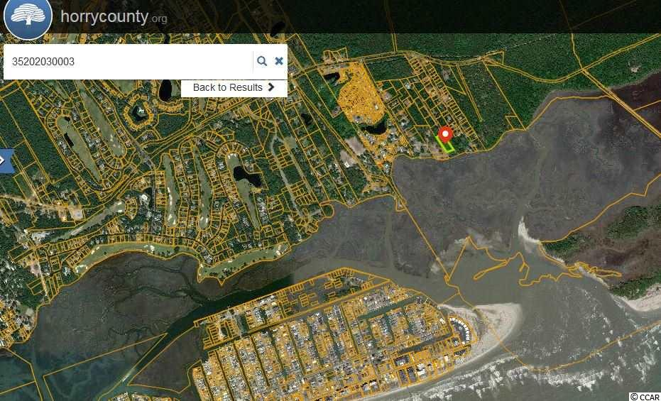 Seller is a licensed SC Real Estate Salesman. Beautiful Lot Fronting Twin Oaks Road; situated on the land side of Hog Inlet and Cherry Grove Point.   NO HOA Dues.  No HOA. This is lot 14-B of the previous larger tract known as Lot 14.  The Lot is considered ocean view, marsh view.  Current and Future Views will depend on elevation of the house and vegetation between house and marsh, and effect from future buildings or improvements which can be made on adjoining lots.  The elevation of the lot is favorable for building on the ground level.  The survey shows lot being in flood zone X. The lot is currently considered in the county. Currently zoned to allow you to build a home or have a mobile home.  The City of North Myrtle Beach has applied for a grant to bring water down this road and is expecting an answer in year 2020.  Currently, if buyer wanted to build they would be required to install a septic system and a well.  There are 3 other lots for sale out of the original parcel---Lot 14D Fronts Jacks Circle and Lot 14E is located at the corner of Jacks Circle and Twin Oaks.  Lot B fronts Twin Oaks and Lot C fronts Twin Oaks.  PICTURES are from different points on LOT 14, and may not be Specific to Lot 14-B or other lots created from subdividing the original LOT 14.
