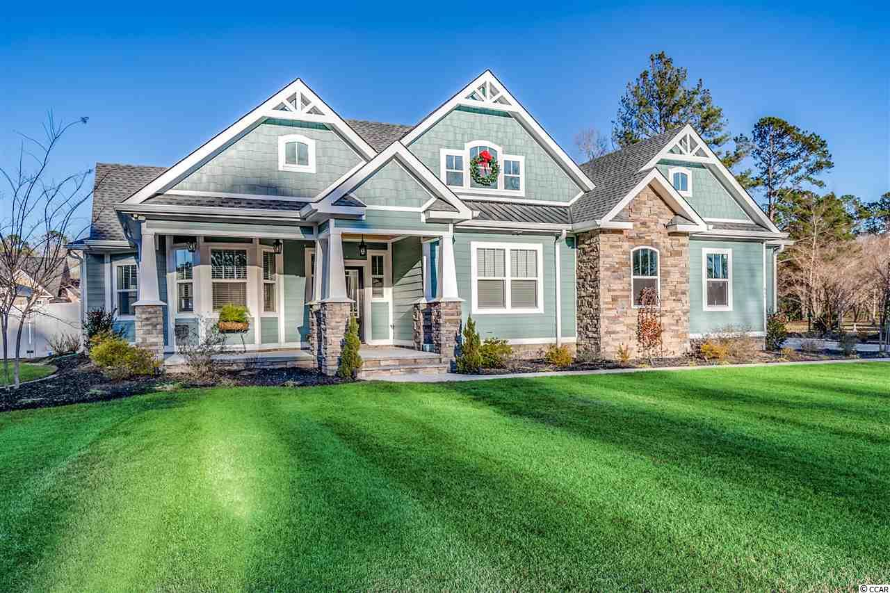 """This exquisite Custom Smart Home, sitting on a 1 Acre lot, in the coveted Long Ave Area of Conway, with NO HOA was built in 2018 and features Craftsman Styling, a whopping 5158 total square feet (4 total beds - 4.5 baths) is just stunning.  The exterior is made of Hardi and Stone with Stained porch ceilings and also includes, city water and sewer, high efficiency heat pump, spray foam insulation in ceiling and walls, and 20 kw whole house generator with Honeywell transfer switch. 30 year architectural shingles and vinyl fencing for the back yard.   Never run out of hot water with 2 tankless water heaters on a leased 500 gallon propane tank.  As you arrive home you'll love the beautifully landscaped yard, complete with lighting and irrigation. The main home offers three bedrooms with in suite baths, a half bath, formal dining and breakfast nook, large living room with built ins, spacious kitchen with stainless steel appliances, custom cabinets, work island and an oversize gas range with hood.  You can see the pool area from the living room, breakfast nook, master bedroom and the covered back porch.  There are trey/coffer ceilings in the living room and master bedroom.  Throughout the house you will love the """"little things"""" like luxury vinyl plank, tiled shower, granite counter tops, 2 separate garages, backsplash and dining room wall with brick accent. AND THERES MORE - This property also features a gorgeous mother in law/pool house, perfect for guest and family, with a complete kitchen, living room, bath and bedroom. The back yard Pavilion/Pool Deck area will be the envy of the everyone.  Relax on the large paver pool deck, take a dip in the 24x42 in ground pool, roast marshmallows at the fire pit area and then head to the giant outdoor kitchen area to prepare a meal that can be eaten in the outdoor pavilion area while watching your favorite tv shows or movies on the projector. There is also a 50 AMP RV Hookup if needed and anytime you get homesick - just pull up vi"""