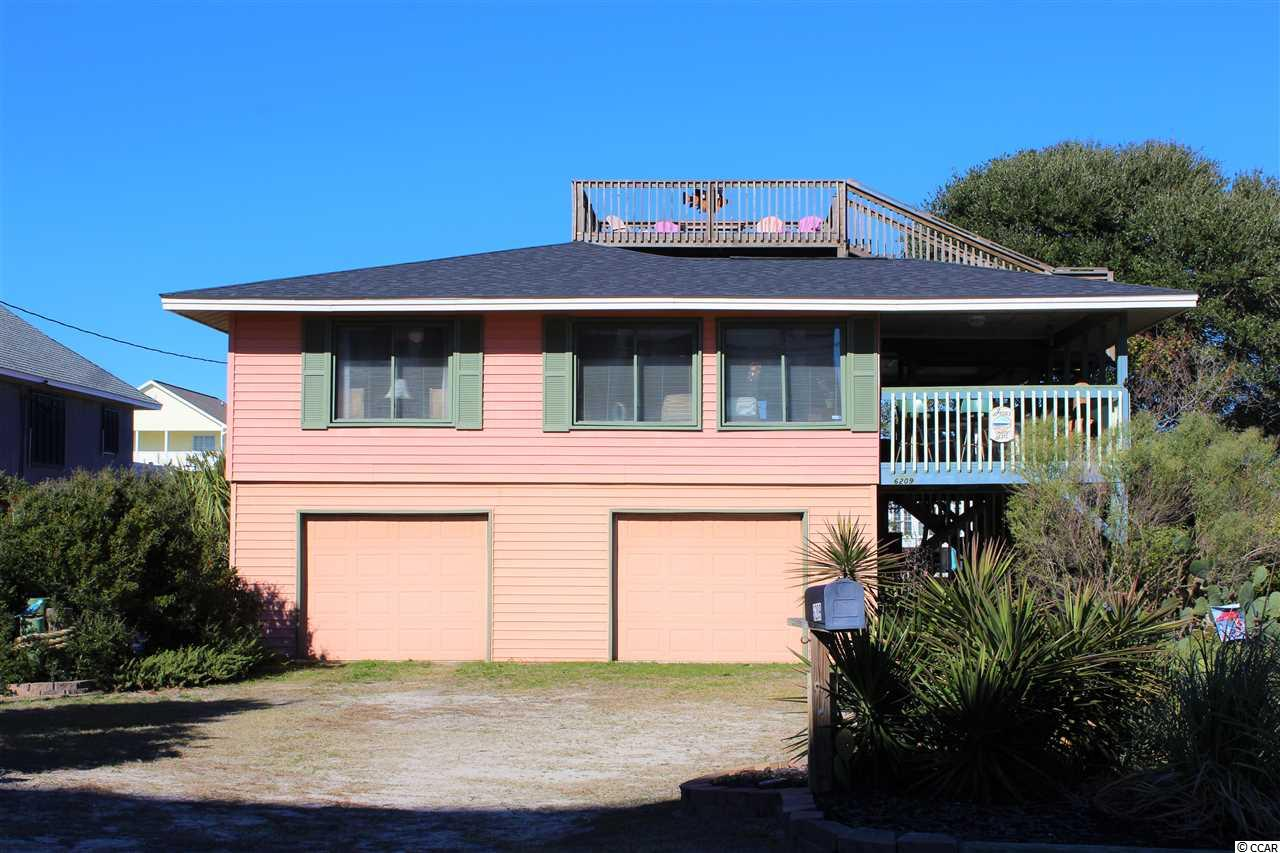 "Located in a highly sought-after section of Cherry Grove - ""The Point!"" This home boasts 5 beds, 3 baths, an updated kitchen, enclosed 2-car garage with private side door entry, a new roof in 2019 and much more. Large windows flood this home with tons of natural light all day and offer spectacular ocean views. Downstairs you will find a separate living space with a living room, full bath, bedroom, leading to a private covered concrete patio overlooking the marsh. In back of the home is a private outdoor shower and large storage room where the golf cart, that conveys with house, is kept. Endless options for entertaining - this property lends itself to an abundance of covered patio space for dinner parties or relaxing while you watch and listen to the waves breaking just across Ocean Blvd. Walk up to the crows nest on top of the house and you'll find stunning 360 degree views of Cherry Grove including: The ocean, The Point, and the marsh right in your back yard. Never used as a rental but a great opportunity as this property sleeps up to 16 comfortably. Located at the end of the boulevard, you have very little traffic and no parking is allowed in front of the house. If you want a true ""Beach House"" feel in a perfect location with direct beach access across the street, this is it!"