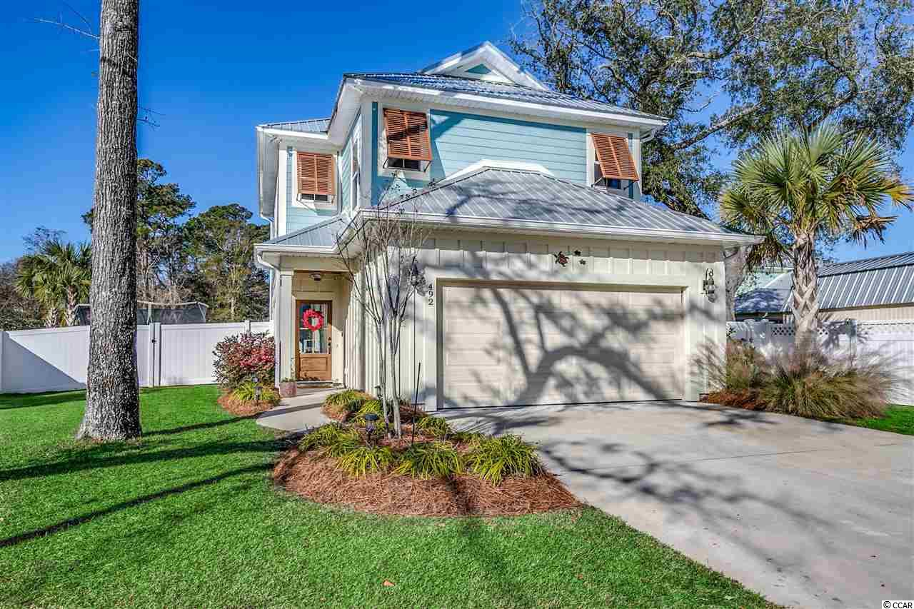 Welcome to 492 Minnow Drive, your own oasis with a pool, just a short golf cart, bike, or walk to Pawleys Island Beaches located in the heart of Pawleys Island.  Pride of ownership is recognized immediately in this less than 4 year old home with 3 bedrooms, 2 1/2 baths, Hardi-Plank with a metal roof and many other updates.  Upgraded engineered hardwoods in the great room, kitchen, and kitchen eat-in area.  Kitchen with stainless steel appliances, granite counter tops, breakfast bar, and walk-in pantry.  Laundry room with ceramic tiled flooring and cabinets.  Large master bedroom with double tray lighted ceilings, sitting area, and walk-in closet.  Master bathroom with granite counter tops and a tiled shower.  Other features include an 8 x 15 screened-in porch overlooking a private, fenced in back yard with an in ground pool and detached storage shed, an outdoor shower, Rain Bird irrigation system, self closing drawers & cabinets and recessed lighting throughout home, ceiling fans with lights in great room, 2nd & 3rd bedrooms and screened-in porch, and wood shelving in the garage. Don't miss your opportunity to own an updated home conveniently located near shopping, dining, night life,  beaches, and championship golf courses.  Myrtle Beach 25 miles, Georgetown 10 miles, and Historic Charleston 70 miles away.