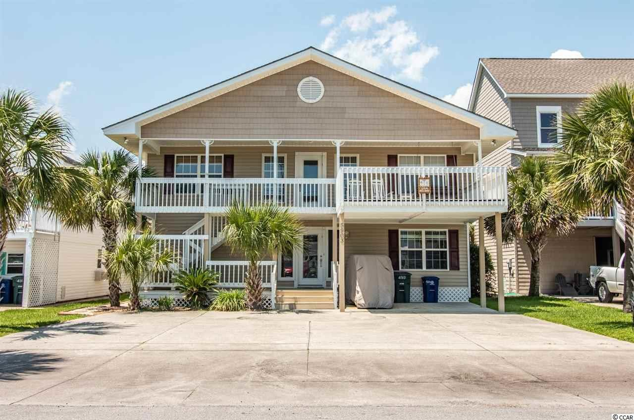 This never rented home is in excellent condition and  is on one of the most desirable streets in Cherry Grove. Being on a deep water channel adds to the appeal.  It has unlimited views of the Inlet and Waties Island.  It has direct access to the ocean thru Hogg Inlet.  Enjoy boating, fishing, kayaking and swimming in your own back yard.  It has a cleaning sink,  a 8' x 16' floating dock, a 8.5' x 16' stationary dock and a boat ramp.  There are two fireplaces, ample lounging areas and a large master bedroom.  A big screened porch on the channel side offers many opportunities to relax and just enjoy the view.  The roof is two years old and there is a new HVAC.  Other upgrades include: all new windows, new hot water heater, bathrooms upgraded, all new flooring and the porch was screened in. You won't want to miss this one!!  Square footage is approximate and not guaranteed.  Buyer is responsible for verification.