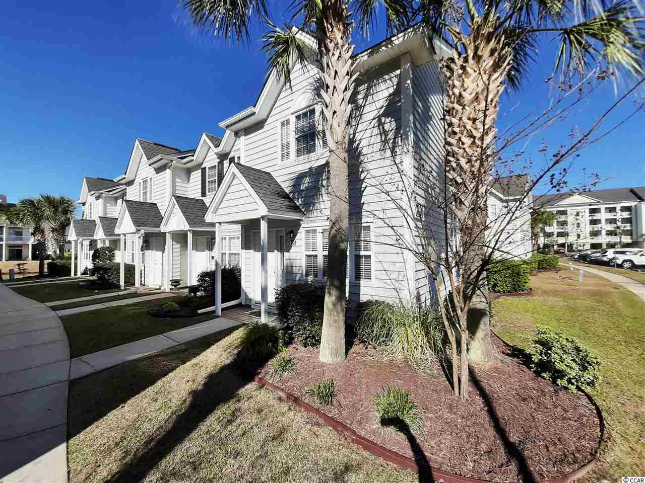 Welcome to Villas @ International Club in Murrells Inlet. A gated resort like community perfect for full time residency or a second home / golf retreat. This END UNIT 2BR/2.5Ba townhome conveys fully furnished and comes with all major kitchen appliances including washer & dryer. Being an End Unit there are additional windows on both first and second level that provide natural light and brings in the Carolina Sunshine. The first floor offers a spacious living room area, dining, kitchen, half bath and a walk in storage area beneath the staircase. Upstairs are 2 bedrooms, each with private baths and walk in closets. The Laundry is also located upstairs adjacent to the bedrooms. Just off the kitchen is a patio area that includes an attached outdoor storage closet and PVC privacy fencing. Villas at the International Club borders the International Club Golf Course, is gated and has a private pool area for residents and guest. The community is conveniently located close to the Murrells Inlet Marsh Walk, Huntington Beach State Park and Brookgreen Gardens. This home has always been a second home only, never occupied full time and never rented. A New HVAC System was installed January 2020. Don't miss it !! Call today with any questions or to schedule a time to view this exceptional home.