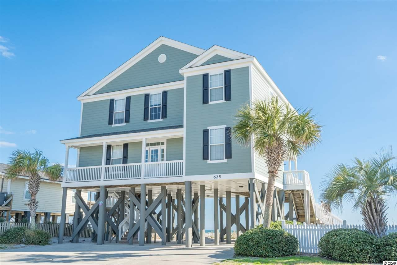 Located on a gorgeous Oceanfront lot with amazing views, this 5 bed, 5.5 bath home features a large open space, boasting tons of natural light, a large deck for out door entertaining and a 2nd living space upstairs. The kitchen offers beautiful granite countertops, lots of cabinet space, SS appliances & breakfast bar. Each bedroom is spacious and offers ample closet space. Sit and relax with your morning coffee or afternoon beverage on the beautiful deck, enjoy time at the heated pool and enjoy runs on the beach. Conveniently located to Garden City & Surfside Beach Piers, dining & entertainment, shopping, golf courses and so much more!  Don't miss your chance; schedule your showing today!