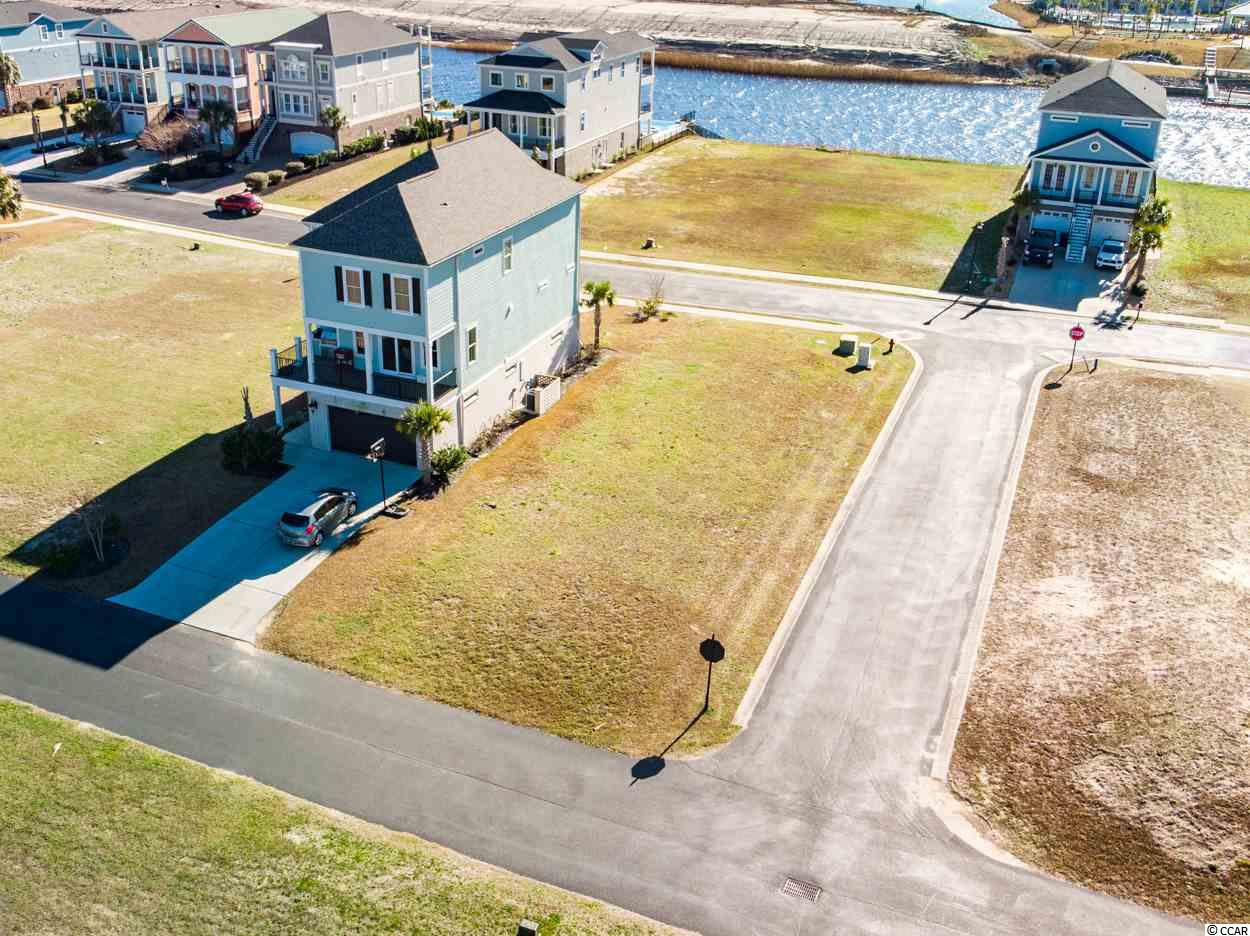 This is a wonderful corner lot in the Battery on the Waterway! The existing homes have the Charleston look and feel, but this waterway community has a character all its own. With a boat landing providing access to to waterway and plenty of extra curricular activities to do. Walking and biking are big here. Enjoy the Hulk bike trail or a casual ride. This community is centrally located to everything Myrtle Beach has to offer! Come check it out!