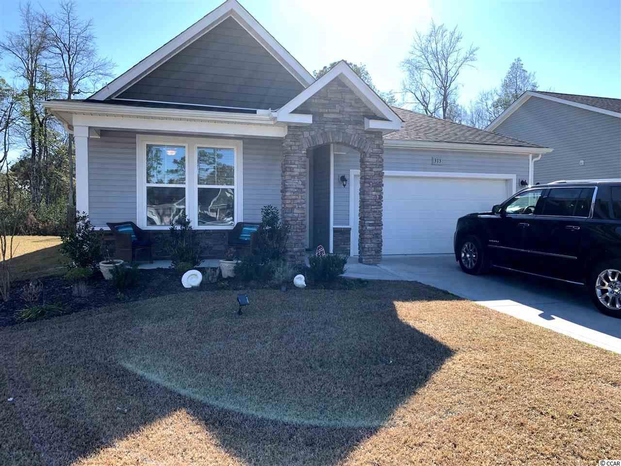 Like New, H&H Homes, Eden plan completed in 10/2017.  Current owners down sized to this home in 10/2018. Don't miss your opportunity to move into this Charming Cottage at Shaftesbury Glen. This home has 5' vinyl laminate flooring running throughout Family Room, Kitchen and Breakfast nook.  Kitchen, breakfast nook and living areas are open concept.  Large island with sink, large pantry, and upgraded Level 2 granite counter tops allow for easy entertaining and living. This home has a split bedroom plan so the spacious Master Suite is tucked away for privacy and includes its own Master Ensuite with double sinks, large walk in shower with bench, linen closet, water closet and large walk in closet. Flex Room is being used as a formal dining room with upgraded French doors, could easily be used as a third bedroom.  Front bedroom is a rarely used guest bedroom.  Drop Zone just outside laundry area offers storage and organization for coats and shoes when coming in from the 2 car garage.  Built with 30 year shingles. Original upgrades include alarm system, 3 windows in dining area, trim package, bay windows in breakfast nook area and master bedroom, French doors, drop zone, 5 inch vinyl laminate flooring, Elevation C stone facade on front of cottage. Owner added upgrades to include plantation blinds throughout, ceiling fans, storm doors at front entrance and back door; Shelving in garage; Additional patio concrete extended to 10 x 19 ft.; Sunsetter motorized, retractible awning with wind sensor and matching Power Screen to create enclosed patio space.  Patio has ceiling fan and mounted TV(cable added); 5 ft. Black aluminum fencing around back yard and additional knock out roses along outer rear fence wall.  Home backs up to woods/back of golf course. Some furniture negotiable, tv mounts being left.  TV's in living room and bedrooms will Not stay.  TV on patio will stay.  Receipts included for new upgrades. Don't forget your amenities package! Golf membership for life (pendin