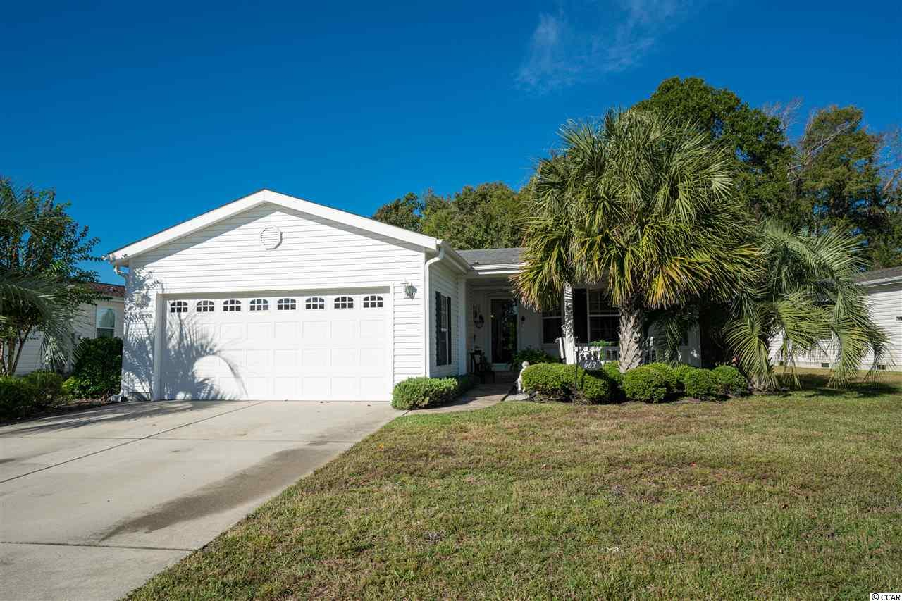 This is the very popular Augusta model Palm Harbor Homes. The home is located in the gated Lakeside Crossing development, a 55+ community that offers wonderful amenities for its residents. This home is built in 2009 and is wonderfully maintained. It features 1,760 sqft of living space with crown molding throughout. There are 2 bedrooms with either a room for a den or 3rd bedroom. There are extra shelves in the pantry, roping detail on the cabinets and a coffered ceiling in kitchen. The dining area features a beautiful Italianate lead chandelier and a tray ceiling. In the garage and attic there are custom shelves for additional storage space. An extra large Carolina Room (15x20) was added in 2017 to enjoy sitting and looking at the lake view. The sprinkler system was recently updated with a new timer and sprinkler heads. Built in 2009, the landscaping has matured nicely with 3 large palm trees on the property. It is only a 3 minute walk to the amenity center where there is an event planned everyday. Located close to the CVS, Walmart, and other shopping. A 15 minute drive to the beach! Come see this beautiful home!