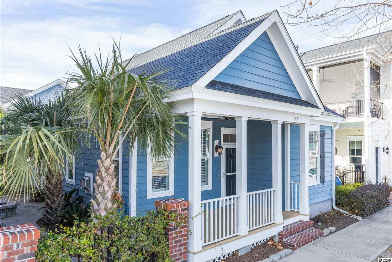 Welcome home to this wonderful home in Sweeetgrass in The Market Common! This is the rare one-level King Street Cottage floorplan with the additional Mother-in-Law suite. This home is filled with historical, architectural, and low-country coastal themes. With the 3 bedrooms being on the first floor, this is one-level living at its best with an open floor plan. These bedrooms are all hardwood, all feature ceiling fans, ample storage and the whole interior is freshly painted. The owners' suite has tray ceilings, hardwood floors, a tile shower, double vanity, and custom closet. The kitchen has white cabinets, stainless steel Samsung appliances, a gas range, breakfast nook and beautiful granite countertops. Access the side yard through the front porch, back porch, or through the custom French side doors near the kitchen. This courtyard has mature palm trees, irrigation, a gas fire pit, and is fully covered with pavers. The side yard has several different spots to entertain and is also low maintenance. There is also a gas line to grill in your backyard oasis. The oversized 2-car garage has windows, shelves, and the garage door had just been replaced. Above the garage is the mother-in-law suite that features a large room with a murphy bed, full bathroom, and private entrance with a balcony that overlooks Sweetgrass. The home has plantation shutters and gutters as well. The HOA fee includes common area maintenance and lights, basic cable, internet and The Market Common pool! This resort style pool features a large pool, kiddie pool, lazy river, two hot tubs, hammocks, ping pong tables, a pool volleyball net, and gym. Living in this community there is easy access to the beach, dining, shopping, and entertaining... all is a golf cart ride, bike, or walk away! Trails, bowling, a dog park, a movie theater, playgrounds, and gyms are all just some parts of living the lifestyle of The Market Common!