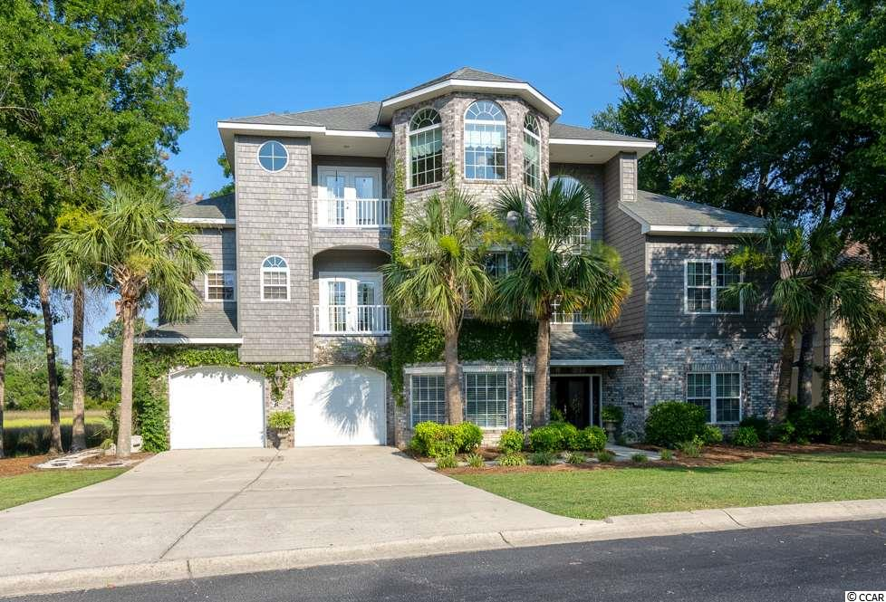 This spectacular home is an amazing oasis from the bustle of the Grand Strand, yet close proximity to the quaint towns of Calabash and Little River, several neighboring world-class golf courses and only 7 miles to N Myrtle Beach's beautiful beachfront.  With breathtaking views of the Marsh and Intracoastal Waterway, you can relax watching boats cruise the ICW in your private, gated community.  The home is in excellent condition with new AC units, new S/S appliances, new back doors and new exterior paint.  There is endless potential with a first-level, over 400 sq ft bedroom (currently used as man-den) to be an in-law suite, teen suite etc.  The main living area is completely open to enjoy the water views from the kitchen, breakfast nook, living room, and dining room.  You must come explore this home to see the serene views and  unexpected niche spaces that give so much flexibility for your family's lifestyle. Fresh neutral paint on interior, new pictures and video coming soon!