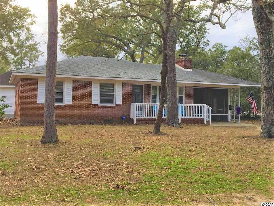This newly renovated all brick home is located just four blocks from the beach and two blocks from Dogwood Lake in Surfside Beach! Updates include electric, plumbing, new HVAC, light fixtures and ceiling fans. The kitchen has been equipped with new cabinets, appliances, quartz counter tops, tile flooring, pantry area and more. The original hardwood floors have been beautifully refinished and the entire interior has been freshly painted. Master bathroom addition includes a beautiful tiled walk-in shower, new toilet, vanity and flooring. The original bathroom has been completely updated from floor to ceiling. Just off the breakfast nook you will find a newly screened in porch with outdoor storage shed, enlarged brick patio with a wood privacy fence and the added convenience of an outdoor shower.  Conveniently located to all shopping, dining, entertainment, medical facilities and much much more.  Ask to see today!