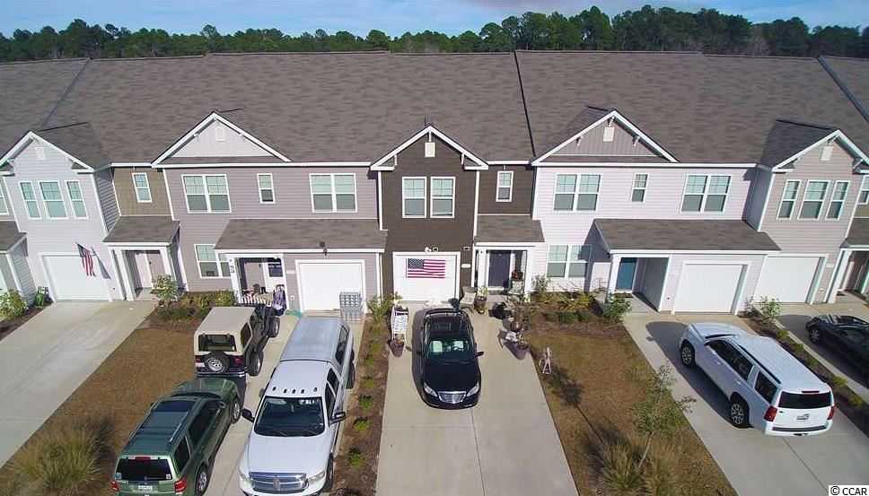 Perfect for entertaining, you're going to love the big beautiful granite gourmet chefs island that is the focal point of this 2018 townhome which is still under warranty! The hip color scheme is fashionable grey with matching ash shaker cabinets accentuated by luxury charcoal vinyl plank wood flooring and complimented by all stainless steel appliances. The kitchen counters are matching grey granite with beautiful flecks of silver and specks of snow white, completed by an elegant granite backsplash. It has a closet pantry and plenty of cabinet space.    Scroll down to the end of the description and click the link to the 4D Virtual Tour, there you can walk through the house like you live there.   This chic, contempory, pristine home has every feature you could want and is well thought out.  Its spacious wide open floor plan is complimented by plenty of natural sunlight to see its spectacular features.  All 3 bedrooms are on the 2nd floor.  The master has cathedral ceilings, ensuite bathroom with grey cabinets, double vanity sinks with cultured marble counters. It has a large ceiling fan and huge master walk in closet that has a window, 3 walls of hanging space and enough room for a long and tall dresser!  The 2 guest rooms have high vaulted ceilings with 6 foot double door step in closets that open like french doors.  This treasured home features oodles of storage space every where from 3 spacious linen closets to attic space and a walk in storage/coat closet under the stairs, and 2 and a half bathrooms.  The long NYC gallery entrance doubles as a mud room.  It includes a seperate laundry space on the 2nd floor.  Did you notice the office space in the loft?  Also for entertaining, It comes with a large cement patio and 400+ square feet of yard space with 2 privacy walls to enjoy your morning coffee...especially since the HOA takes care of your lawn!  In addition it has a private 1 car garage and 4 car driveway for your guests.  You have a small but comfortable covered porch in the front with enough room for a table and 2 chairs.  This home is a wonderful investment and life style choice.  The HOA includes a pool, exterior insurance, live security, lawn maintenance and irrigation, outside exterminating, cable, internet, landline telephone. Your Fairways at Wildwing home is part of the golf resort Wildwing Plantation community. There are walking trails and lakes to enjoy that are a few steps away.  Its within 2 miles of Coastal Carolina University, Horry Georgetown Tech and Conway Hospital.  Its walking distance to 3 supermarkets, Aldis, Walmart, Food Lion, and even the bus line! You are a 15 minute drive to the beach or Historical Conway and River Walk, and in a preferred school district.  Be sure to check out the 4D virtual interactive tour of this incredible townhome. This spectacular home is priced to sell quickly don't miss out schedule a showing today.   All measurements are approximate and not guaranteed. Buyer is responsible for verification.