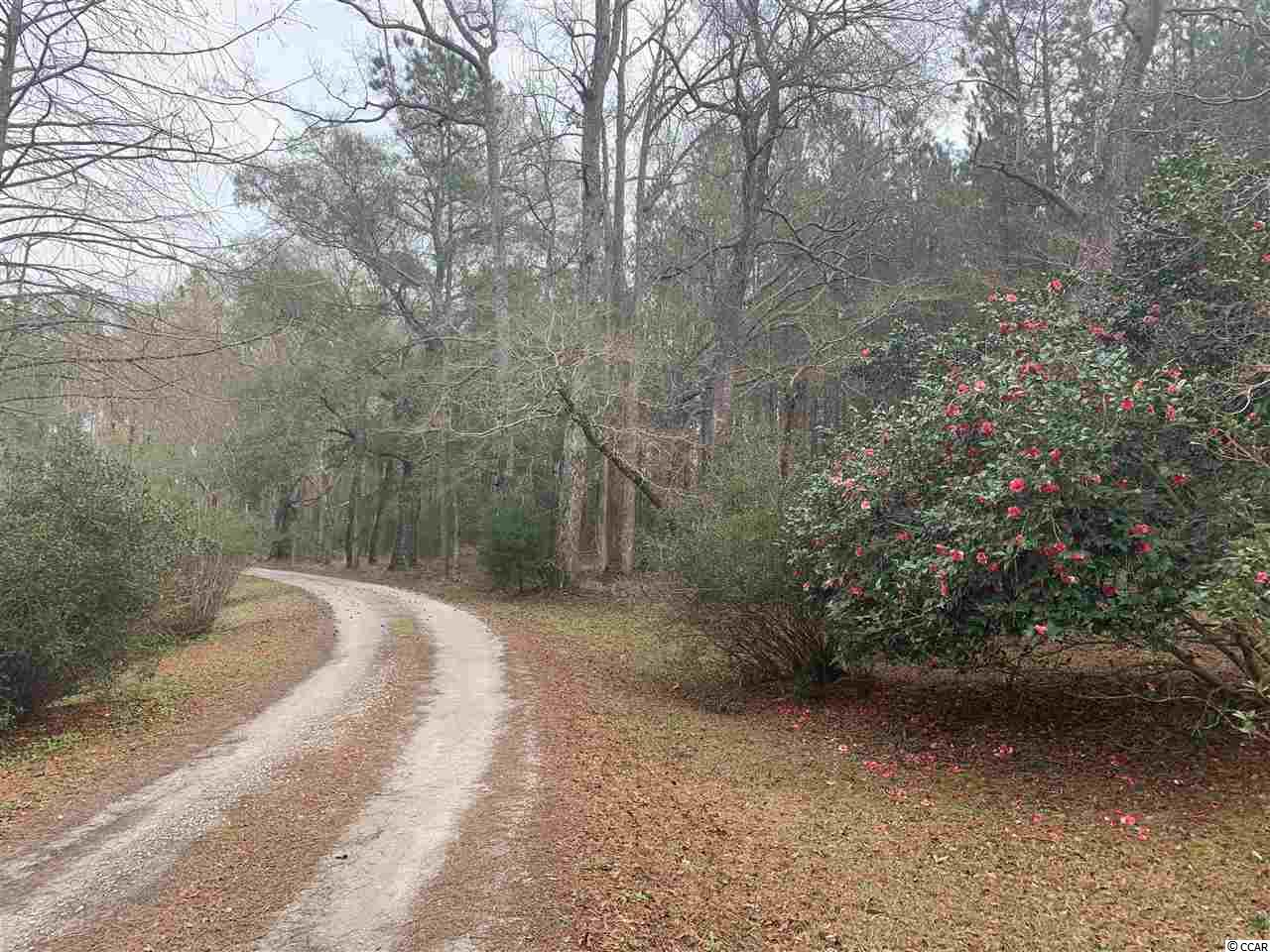Azaloak Rd is a private road that winds through some of the most beautiful acreage in Horry County. Tract B-2 is approximately 24.54 acres, zoned FA. Tract B-2 features several potential home-sites and a very large lake! This is beautiful property that can be used for recreational or residential purposes. Contact an agent today for more information.