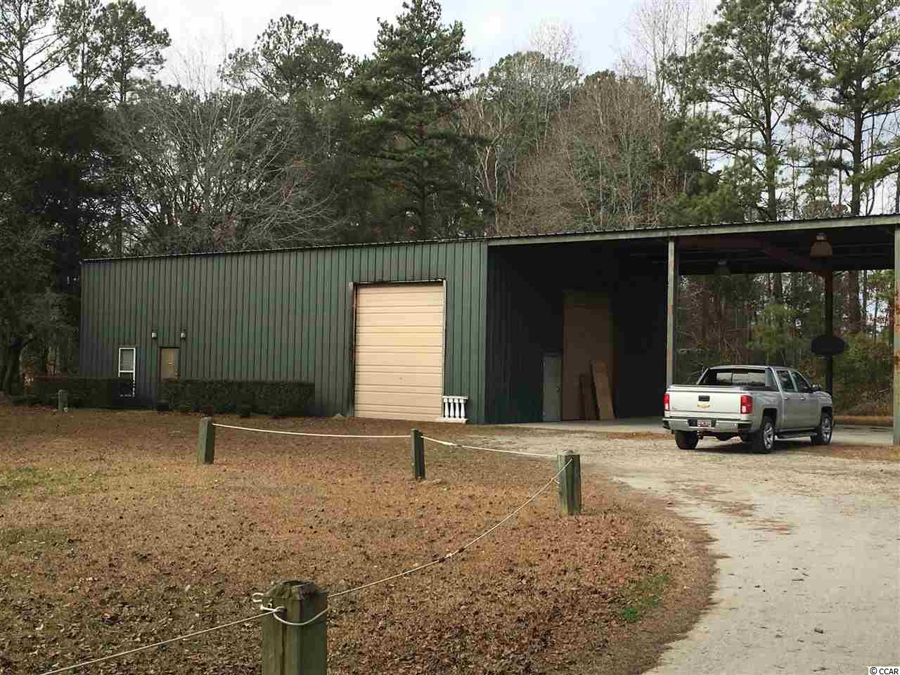 This property Has a 4000 sq ft warehouse on site. approximately 1280 heated/cooled with 4 offices, kitchen full bath and reception area; 1200 sq ft of warehouse with 3 14' roll up doors 20' ceilings and 1520 covered area with concrete floor. Water: well sewer: septic. Direct access to the Waccamaw river. Did not flood. Approximately 4 miles from downtown Conway. Approximately 10. 5 miles from the intersection of Carolina Forest Blvd & Hwy 501.  All measurement are approximate and buyer is responsible for verification.