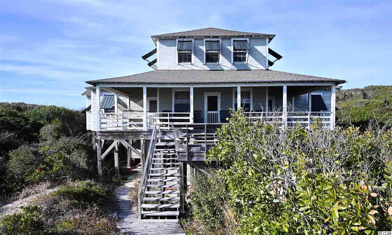 "Once in a lifetime opportunity! The largest ocean frontage lot on Pawleys Island is now for sale. This unique estate is in the Historic District of Pawleys Island. SC. An all wood, 5-bedroom cottage built in 1938 by the original owner's great grandparents, rests on top of a dune facing the ocean with sweeping views. A great porch overlooks the 180 feet of ocean frontage and over 1.3 acres of high dunes and ocean oaks.  Surviving well the years and storms due to excellent construction and dune protection. Hidden from the road by seaside oaks, the home has an air of privacy, tranquility and solitude. There are two backdoor entrances with decks and built in seating. Inside, the all wooden walls tell stories of the love and memories spent in the home throughout the many years. The cottage includes a separate dining room, playroom and second floor dormitory style bedroom with bath. The large outside shower has a private changing area.  Due to the age of home, it is selling ""as is where is "". Every inspection is welcome.  The lot qualifies for subdivision into 3 oceanfront lots. This location is the best Pawleys has to offer. Sprawling across some of the highest dunes and best vistas of the middle of the Island, enjoy a true chance to live the good ole days of SC beach life. This estate accurately presents the arrogantly shabby charm that Pawleys Island has made famous. Serious inquiries only. Have your agent arrange for your private showing soon! See Plat in Additional Documents"
