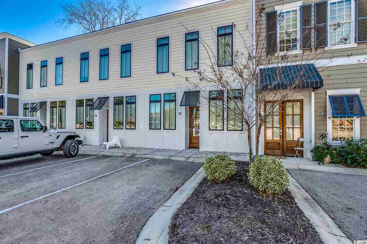RARE FIND IN THE HEART OF MURRELLS INLET!  Beautiful open concept with high ceilings, brick accent wall, full size refrigerator and freezer, quartz counter tops, shaker style soft close cabinets, stainless appliances, with gas range.  This unique townhouse features two bedroom suites each with it's own private bath.  Walk or bike to the famous Marshwalk and enjoy all the Low Country has to offer.  Schedule your showing today!