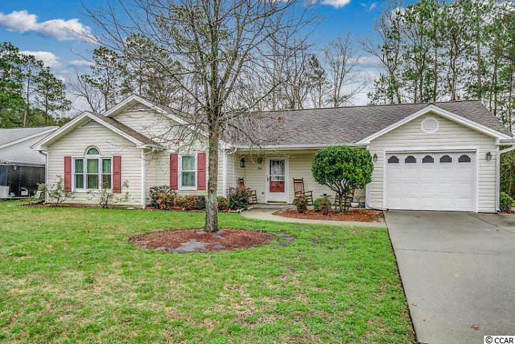 Cozy and inviting home is located in the Castlewood community of Conway with no HOA! This home features vaulted ceilings throughout many of the common areas and the easy flowing floor plan connects the spacious living room with the dining area and the open kitchen with a breakfast bar and plenty of cabinet space. The three generously-sized bedrooms each feature a closet and ceiling fan. Two of the bedrooms share a full bathroom, accessible from the hallway, while the master bedroom features an ensuite master bathroom. For convenience, the hallway provides access to additional closet space and the laundry closet. The living room also connects to the comfortable, well-lit Carolina Room with a wooded view perfect for starting or ending your day. Through the Carolina Room, there is a large patio for grilling and enjoying the outdoors. The patio connects to a path that will take you to the side entrance of the one-car garage or the driveway in the front of the home. The exterior of the home also features a large front porch and driveway parking for at least four vehicles. Your Castlewood address, located between Conway and the Atlantic Ocean provides you with close proximity to all the attractions and amenities of Myrtle Beach, including fine dining, world-class entertainment, ample shopping experiences along the Grand Strand, and Conway's antique shops, local eateries, and the River Walk. This home is just off SC-544 and a short drive down Myrtle Ridge Drive to Hwy 501. Rest easy knowing you are only a short drive from medical centers, doctors' offices, pharmacies, banks, post offices, and grocery stores. Square footage is approximate and not guaranteed. The buyer is responsible for verification.