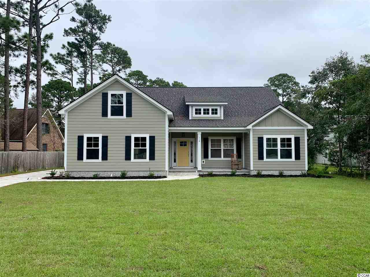 Under Construction! No HOA! Low Country style cottage home with impressive standard features to include LVT floors, granite counter tops, stainless steel appliances and carpet. Close to the shops, restaurants, golf courses and beaches of Pawleys Island. Take comfort in one of our newly constructed homes that has a reputation for quality and value. Whether you are a first-time home buyer or looking for your next home, Let us help you through the buying process and welcome you to your new home.