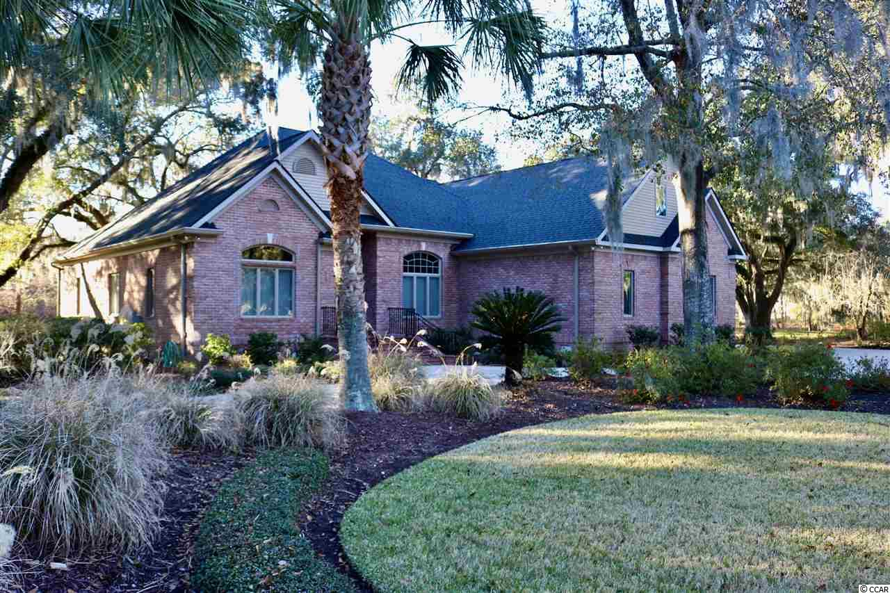 ONE OF THE MOST BEAUTIFUL SETTINGS IN ALL OF WILLBROOK. THIS HOME AND LOT & HALF WITH ALL ITS CENTURY OLD OAKS HAS ALL VIEWS, IT IS PROTECTED ON TWO SIDES BY A NATURE PRESERVE. YOU CAN SEE WATER AND THE GOLF COURSE. This  all-brick home set among beautiful moss-covered live oaks and beautiful landscaping with many varieties of flowering shrubs and  palms. The wonderful view of woods, and wetlands gives you a total feeling of relaxation. Walking out the front door is a large lake surrounded by a row of lovely old oak trees and a view of the golf course. This Home is situated on a cul-de-sac and is adjacent to the site of the Historic original old plantation home. There are may features added to this home: Onan 20KW whole house Generator, Rinnai tankless Hot water Heater, Gutter Guards, 27X24 StorWall Heated Garage,14X13 Den, Landscape Lighting, EcoWater refiner system 2018, and Bosch Gas cooktop, 17X15 Master Bathroom 11X7 laundry room,  his(10X9) and Her (14X6) walk-in closets + new roof 2019 and 2017 Trane A/C system see attached sheet for many more features. This exceptional property is located in a gated golf course community with pool, tennis, clubhouse, fishing and crabbing dock, and best of all, Private Ocean Access to the pristine white sandy beaches of Litchfield with ample parking, oceanfront clubhouse, deck, restrooms, outdoor showers and more. Just minutes to Huntington Beach State Park and the famous Brookgreen Gardens, Murrells Inlet Waterfront Marsh walk and Charleston is also close by. Let the shabby Elegantly luxury of Pawleys Island and the laid-back, Low-Country lifestyle reel you in...