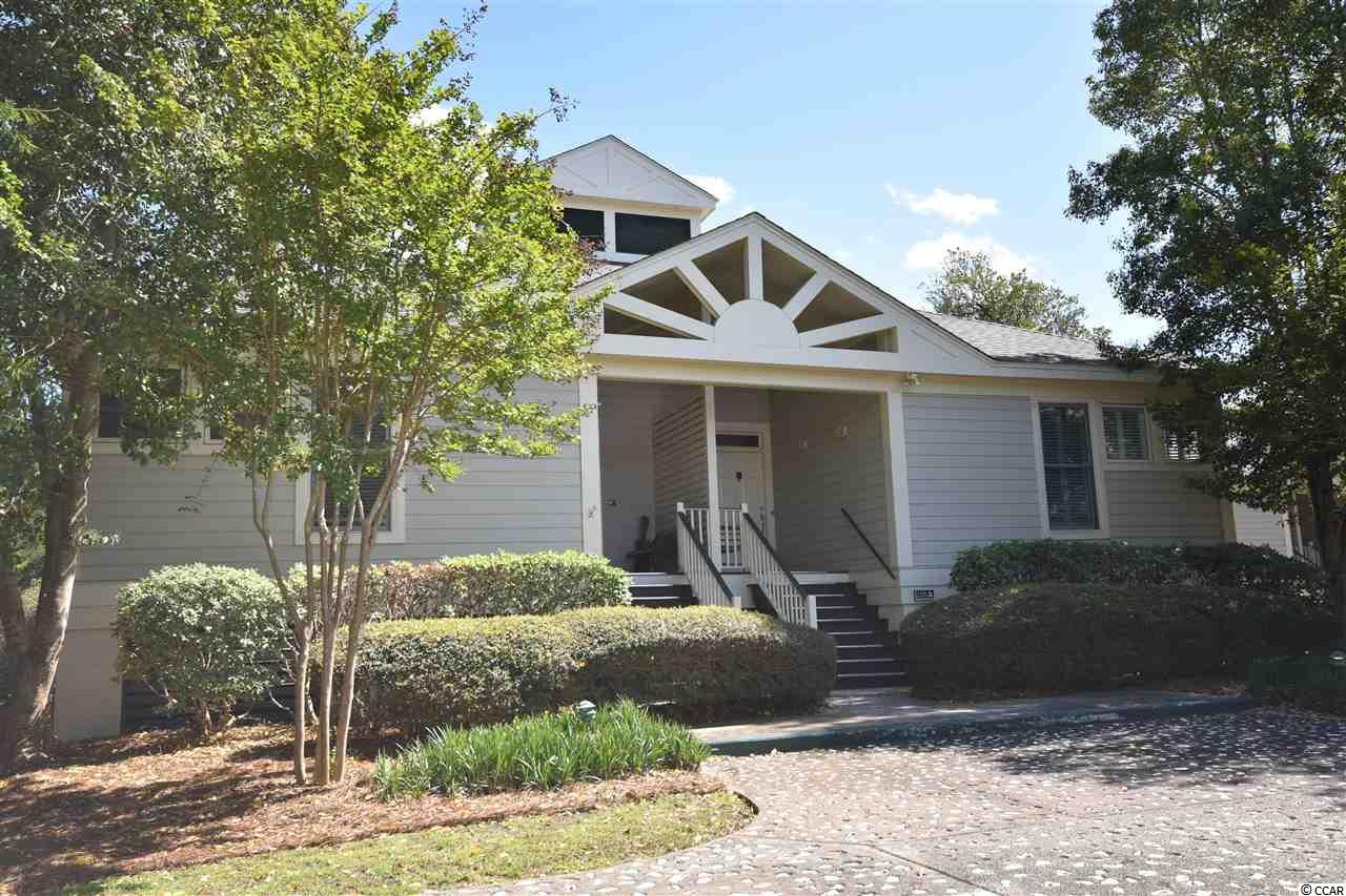 Enjoy the sea breezes and lake view at this single floor 2 bedroom, 2 bath, newly updated Lakeside Villa at Litchfield By The Sea. This unit has all hardwood or tile floors, new fully functioning windows, a generous screened porch on the lake, extra storage under the unit, extra cabinets added in the kitchen and master bath, custom built-ins, custom wood counter tops in kitchen, an electric fireplace for those chilly days....the list goes on and on. This unit has never been on the rental market and is in immaculate condition. Community pool, bike to your private beach access, tennis courts, pickle ball, great local restaurants. 30 minutes to the Myrtle Beach airport and 1.5 hours to Charleston airport.