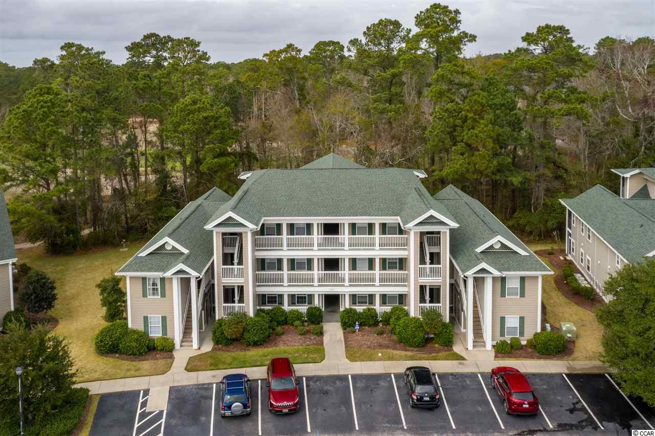 "The number one request when searching for a condo in Pawleys Island is ""I want something with NO stairs!"". How fortunate that this terrific, furnished, 3 bedroom, 2 bath is located on the ground floor in the beautiful golf course community of True Blue.  This condo backs up to the Steve Dresser Golf Academy so there are not ""flying golf balls"" invading your space as you enjoy the serenity from your screened porch out back. This condo is flooded with natural light but feels very cozy and serene at the same time. The owner has it chock full of antiques, but those will be going with the seller. You'll find all the ""basic"" furniture as well as all appliances including the washer and dryer, 4 flat screen TVs will convey with the sale. Whether you're looking for a vacation/2nd home or a terrific investment property, this is the condo for you! HOA Fees include the exterior building insurance, water and sewer, trash, pool service, all landscaping, security, basic Cable TV and internet, common area maintenance, and pest control. You are just 2 miles away from the pristine beach of Pawleys Island, 8 world class golf courses within 5 miles and Charleston only a 90 minute drive away. Come see for yourself why True Blue is one of the most coveted condo communities in Pawleys."