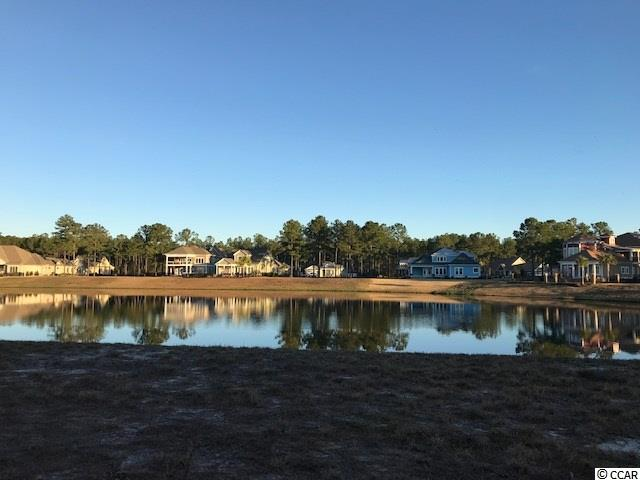 Beautiful Lake Front Lot in the gated community of Waterbridge. Perfect location for your Dream Home! This lot has long water views of the lake with an easy walk to the amenities center. Amenities include an amazing pool area, fitness center, walk down fire pit, swim up refreshment bar, tennis courts, volleyball and basketball courts,  boat ramp and pier. Located in the heart of Carolina Forest.  No timeframe to bring.  Bring your own builder.