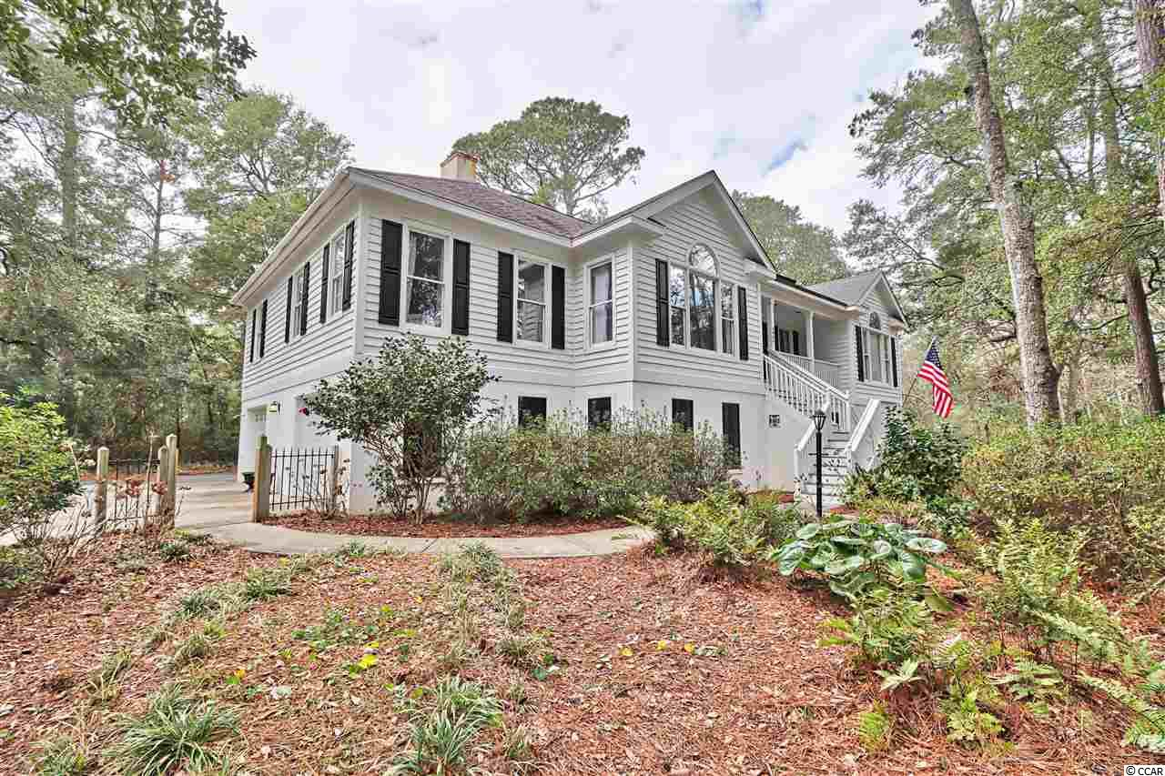 If you've been searching for the perfect Murrells Inlet dream home east of highway 17 and only a few rows back from the inlet waters, then search no further! This is the perfect home at an even more perfect price. You will not find another raised beach home of comparable value east of highway 17 in all of the inlet, with this much square footage, 4 bedrooms and 3 full baths, sitting on a third of an acre, incredibly low HOA dues, with such unique features. Boasting over 3200 heated square feet, as well as roughly 2200 square feet of space under the home in garage space with built in workbenches and plenty of room to store all the toys, boat, jet-skis, kayaks, bikes, motorcycles, and more! Only a stone's throw away from the inlet and everything the famous South Carolina Marsh Walk has to offer. Whether you are an avid boater, nature enthusiast, or just love living the lowcountry lifestyle, this home can accommodate anyone. Located in a very secluded neighborhood, Huntington Marsh is tucked away among the trees and is a small and quiet neighborhood off the beaten path. At the entrance of the neighborhood is the bike path that takes you only about 1 mile to the prestigious beaches of Huntington Beach State Park. If you head north from the neighborhood, you could ride a bike to Graham's Landing, or a quick stroll another mile up to the famous Marsh Walk. You are only about 25 minutes to the Myrtle Beach International Airport, and all things Myrtle Beach has to offer, and only 25 minutes to the Historic Georgetown Waterfront. They say real estate is all about location, location, location, well it doesn't get any better than this, especially when you combine where this home is located, with all that is has to offer.  Ideal for the family who loves living the true lowcountry lifestyle. On the 1st floor is 1 bedroom and 1 bathroom with a great screened in porch, along with all the storage space in the garage. There is also a fenced in yard for the kids and pets. The main fl