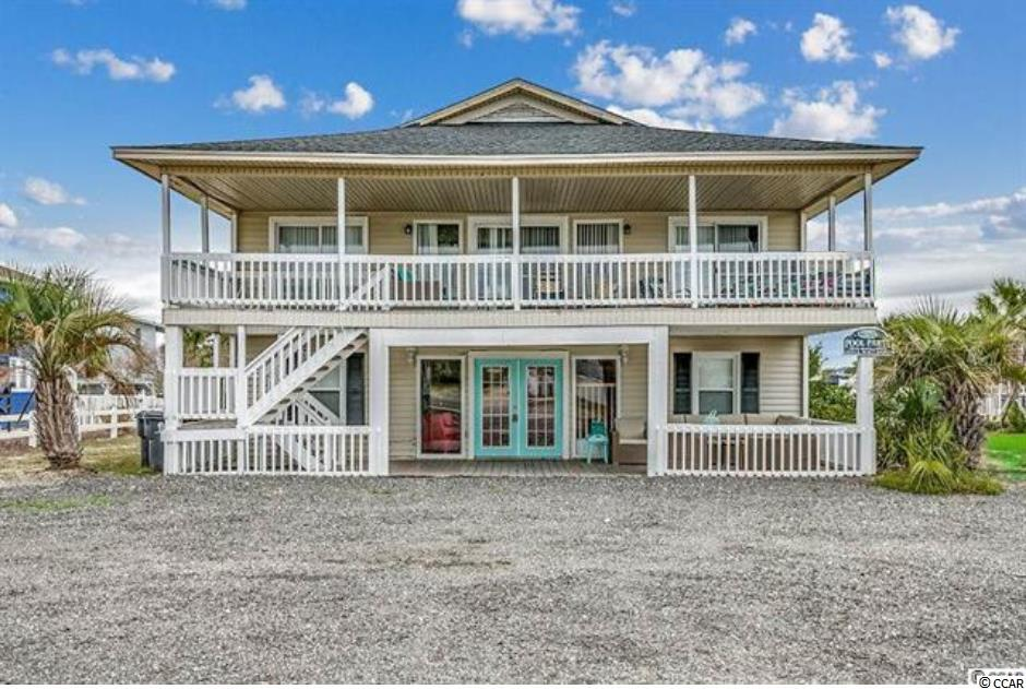 Beautiful beach house in prime location! This FULLY FURNISHED home includes 8 spacious bedrooms with heart-pine floors, 4 full baths, two living areas, two full kitchens, and swimming pool. The main level boasts an open floor plan, four bedrooms, and kitchen. The upper level holds four more bedrooms, another large living room, and kitchen. The kitchens offer granite countertops and stainless steel appliances. The two large balconies on the front and back of the home offer views of the Atlantic ocean or the Inlet, and are the perfect place to catch a morning sunrise or sunset. The home also features a brand NEW roof. This property is perfect for those looking for a family beach vacation home, or an investment property. The property is conveniently located just steps from the beach, and just minutes from the Marlin Quay Marina. Schedule your showing today!