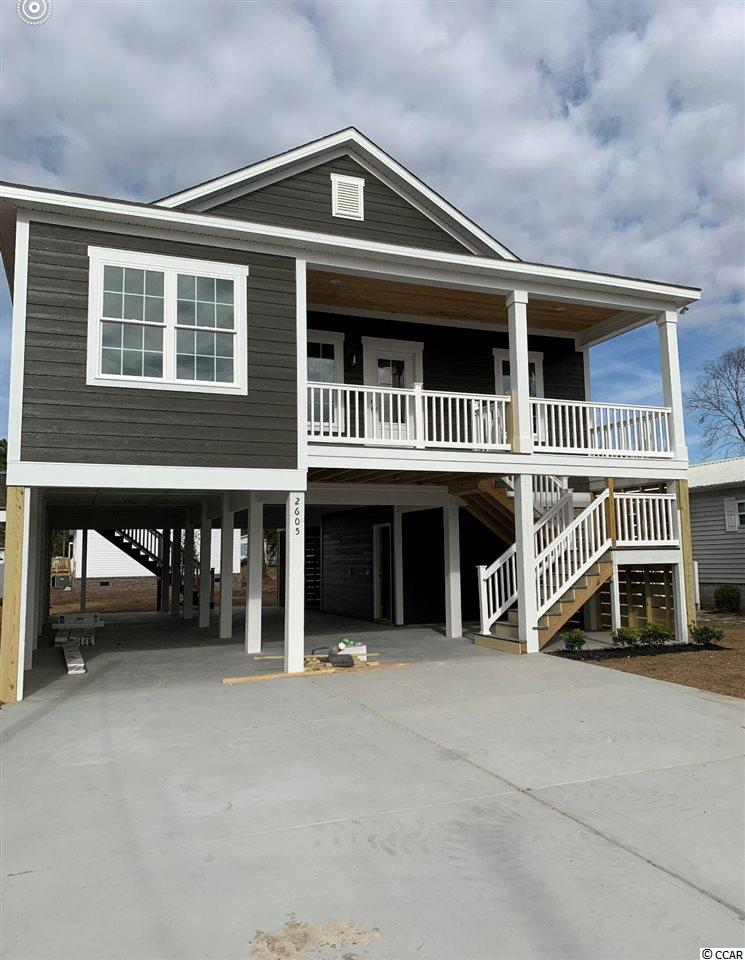 This 3br 2 bath raised beach house can be doubled in size by closing in under the house for living and storage or garage. The Grove has no HOA and is just a little over a mile to the warm sunny Cherry Grove Beach. Hop on your golf cart and ride to the beach, shopping, restaurants and more. It's also just a few blocks away from the ICW. Call today and pick out your colors and flooring.