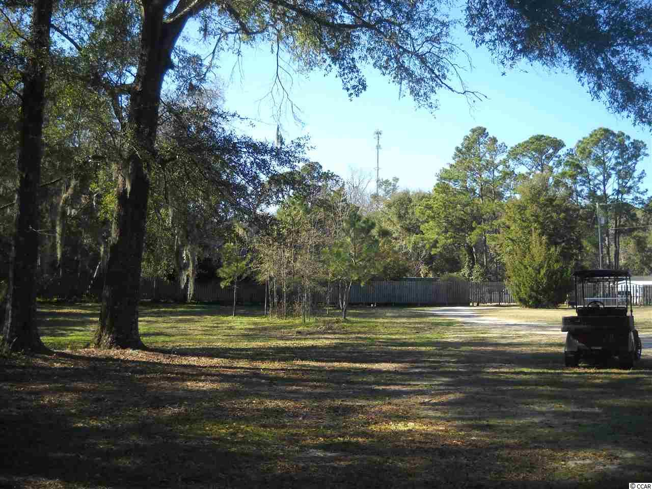 One acre (1 AC) buildable lot off dirt road.  Lot is already cleared.  Some trees, borders a golf course.  Quiet, secluded area with no HOA!  3 acres plus mobile home adjacent is for sale also.  See MLS#2001863