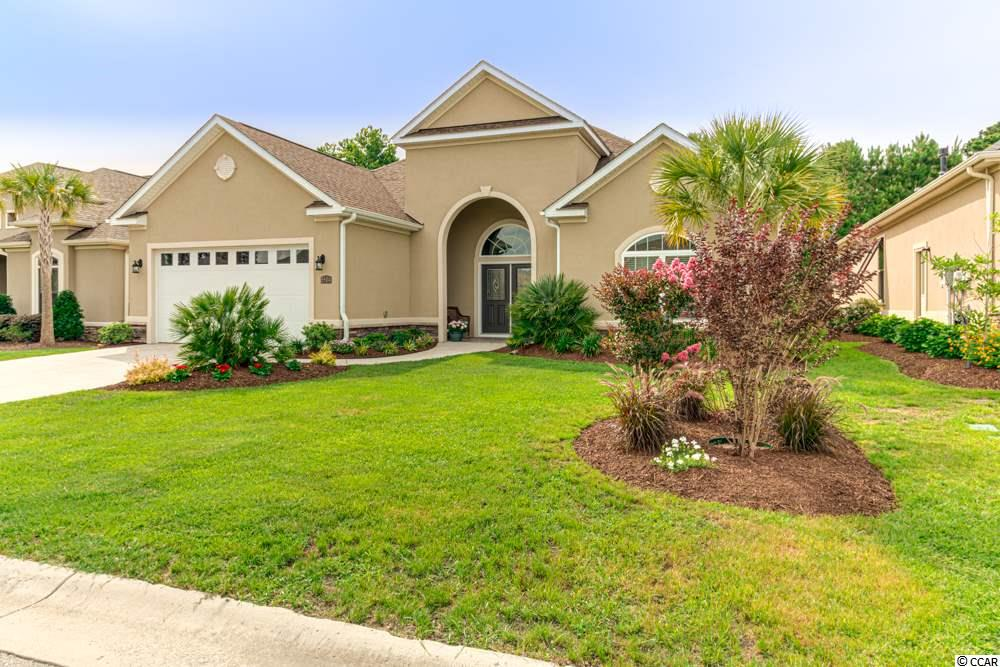 Immaculate 4-bedroom, 3.5-bath Mediterranean style home located in the highly desirable Tuscan Sands community in Barefoot Resort and Golf..This beautiful and spacious home is only a few years old and it shows like brand new..Many upgrades and features include: A spacious living room, formal dining room with beautiful wainscoting and crown molding, first floor master bedroom and a large walk-in closet; master bathroom with a large walk-in shower and double sink vanity; beautiful kitchen with stainless steel appliances, custom made cabinetry, glass tile backsplash, granite countertops and breakfast bar..Crown molding throughout..Hardwood floors in the living room, dining room and kitchen..Spacious laundry room with washer and dryer, custom cabinets, a granite counter top vanity and sink..Private fourth bedroom on the second level with its own bathroom..You can enjoy the outdoors from your porch and your professionally landscaped yard..Located in Barefoot Resort, Tuscan Sands is close to the beach, dining, shopping and all the area​​‌​​​​‌​​‌‌​​​‌​​‌‌​​​‌​‌​​​‌‌​ attractions.