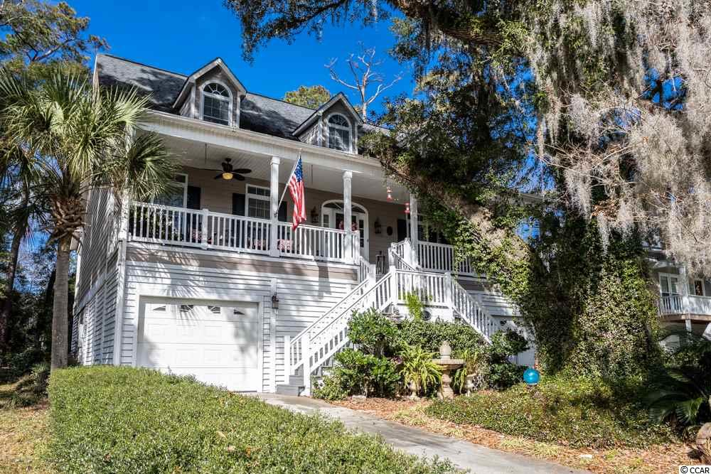 This is an absolutely gorgeous raised beach home East of Business 17 in Pawleys Island!  From a welcoming front porch, you enter into a large Foyer, Living Room with Fireplace and a Dining area. The Kitchen is a cook's delight with Stainless Steel appliances, Granite counters, tile back splash, beautiful hardwood floors and a breakfast bar. There are 3 Bedrooms, 2 full Baths, a Bonus Room and a Powder Room. The Master Bedroom has a walk-in closet, dual sinks, separate tiled shower and a garden tub in the Master Bath. There is a large covered, screened-in tiled back porch overlooking the large backyard with a Gazebo and Patio area. Make plans to see this house and make it your home!