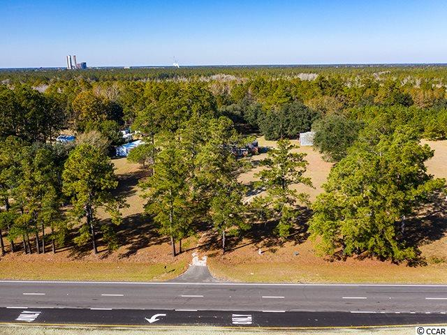 6.1 acres zoned farm/ag and residential located directly across from Horry Georgetown Technical College just outside the city limits of Georgetown. Georgetown Airport is less than 1 mile away.  This property consist of 3 parcels with the BONUS of 2 houses, and a large workshop/building.  Endless possibilities. Approximately 1 hour to Charleston and 45 minutes to Myrtle Beach.