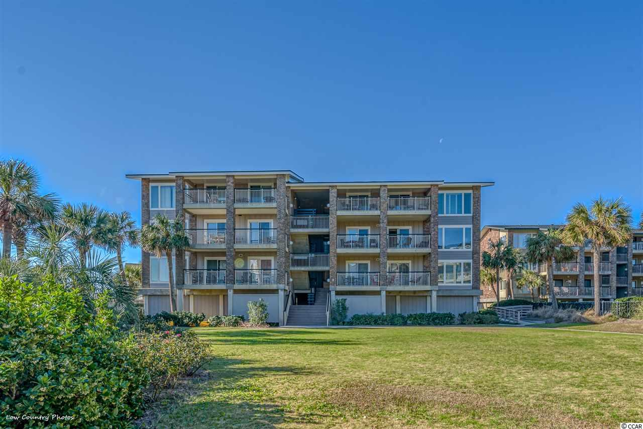 Oceanfront, Private, Gated Community on Pawleys Island Proper with Private Pier.  The only one of its kind. Relax or dine from the immense porch with beautiful ocean views. This spacious condo has a wonderful layout and is sold furnished. The private pier invites you to fish and includes seating, rod holders, cleaning stations and covered cabana. Enjoy an evening walk on the pier to star gaze or watch the sunset. There is a private pool and clubhouse to enjoy with friends and family. For convenience, there are elevators, making this accessible to anyone.  Private covered parking and on-site boat parking are also included. There is a private storage room downstairs for beach chairs and toys.  Pawleys Island offers miles of white sandy beaches, three boat landings, creek access, tremendous history and a laid-back lifestyle. Enjoy relaxing on the beach, fishing, riding bikes, swimming, walking the beach, paddle boarding, boating and more.  Just 1 hour to Historic Charleston and 30 minutes to Myrtle Beach. (no pets allowed)