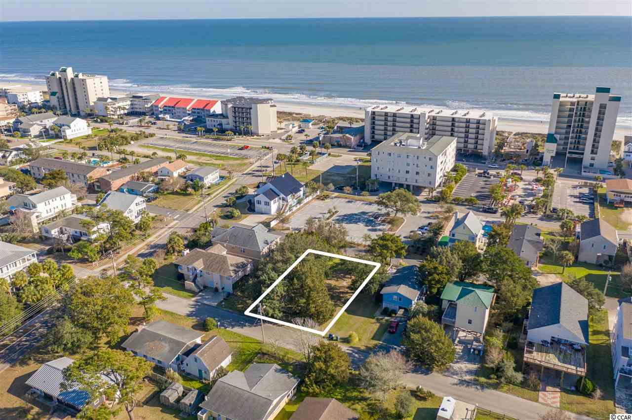 Beautiful lot ready to build your beach dream home in highly sought after Windy Hill section of North Myrtle Beach!  Walk to the beach, bike or golf cart to shopping and dining.  The lot holds gorgeous trees and the previous home has been removed and is ready for your new home!