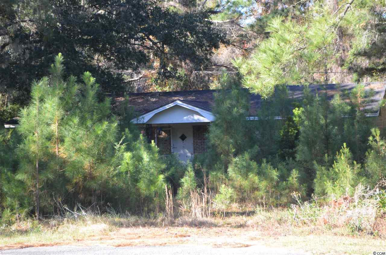 Great chance for a fixer-upper with 11.29 Acres of Land.  House is just off of the main highway, All Brick, one Car Garage.  Large Pond in the back. Just about 10 minutes from the Historic Downtown Georgetown, and just about 1 hour from Charleston or Myrtle Beach.