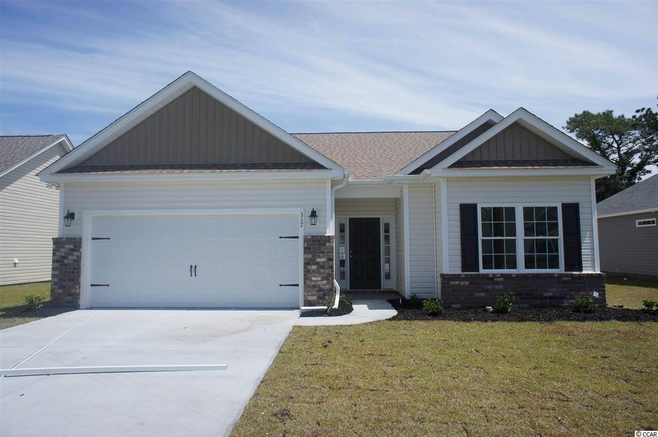 Beautiful Hatteras floor plan in the new Ocean Palms community. This terrific open floor plan, 3 bedroom, 2 full bath home has wood-look vinyl flooring throughout. Stainless appliances, granite counters, staggered-height stained birch cabinetry and a convenient breakfast bar combine to give you the wow factor you're looking for, and abundant recessed lighting plus two large windows in the adjacent dining area flood the room with light. There's even a large walk-in pantry and a dedicated office. A French door in the great room leads to the covered rear porch and the large separate patio beyond. The spacious master retreat features a long vanity, an oversized walk-in shower, plenty of storage in the linen closet and a huge walk-in closet, plus a tray ceiling. Two additional bedrooms and a full bath are tucked off on their own hallway, for privacy.  All of the homes in Ocean Palms come standard with the luxury of natural gas (tankless water heater, gas heat, and gas range). The two car garage is completely trimmed and painted, and a floored attic storage space is accessed by drop-down stairs. Ocean Palms is conveniently located near shopping, restaurants, schools and world class medical offices and hospitals, and only a short golf cart ride to Surfside Beach's gorgeous beach and the beautiful Atlantic Ocean. Other floor plans and inventory homes may be available, and CUSTOMIZATION OF FLOOR PLANS IS POSSIBLE!!! Community Pool and Cabana Coming Soon! Photos are of a completed, similar home and may have different features.