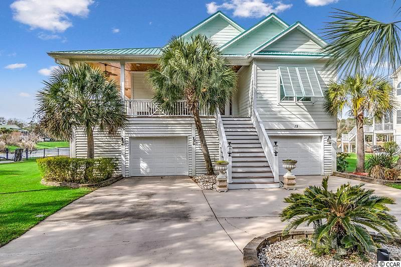 Location, Location, Location! Perfect opportunity to own a 4 bed/4 bath raised beach house located on a private seven-acre lake in a hidden gem neighborhood known as Wachesaw Palms. Wachesaw Palms is located in the heart of Murrells Inlet at a private neighborhood architecturally designed to bring that tropical island feel to 18 unique custom-built homes.  This neighborhood was featured 2006 in Builder/Architect Magazine.  Once you drive into the driveway you will not be able to miss the rare ¾ oversized wrap around porch. Upon entering this amazing property, you will be blown away by the door to door custom Brazilian Cherry hardwood floors. The 10ft ceiling gives you that absolute open floor plan feel that leads you through your living area equipped with gas logs to your gigantic kitchen.  The kitchen boasts stainless steel appliances, custom granite, and rare maple cabinetry with professionally installed storage pull outs. This spacious property also provides a seating area to enjoy your meals and a piano room with a trey ceiling and chair and picture frame molding that could also be used as a formal dining room. This entire second floor has double crown molding through-out and two bedrooms with one being used currently as an office. No matter where you are on this floor, you cannot get away from the breath-taking views of the lake. The owner picked this location due to its unobstructed view of the sun setting across the lake. Let me tell you, it will not disappoint.  So, grab that warm cup of coffee or that adult beverage and take in the inlets best sun sets!   The oversized master bedroom is located on the first floor.  It has double door access to the back yard. It has custom chair and picture frame molding and a walk- in closet.  The master bath is huge!! The owner spared no expense. You will have to see to believe! The first-floor bedroom has access to the back yard also and gives you endless possibilities.  Man cave, theatre room, game room, etc… All of this